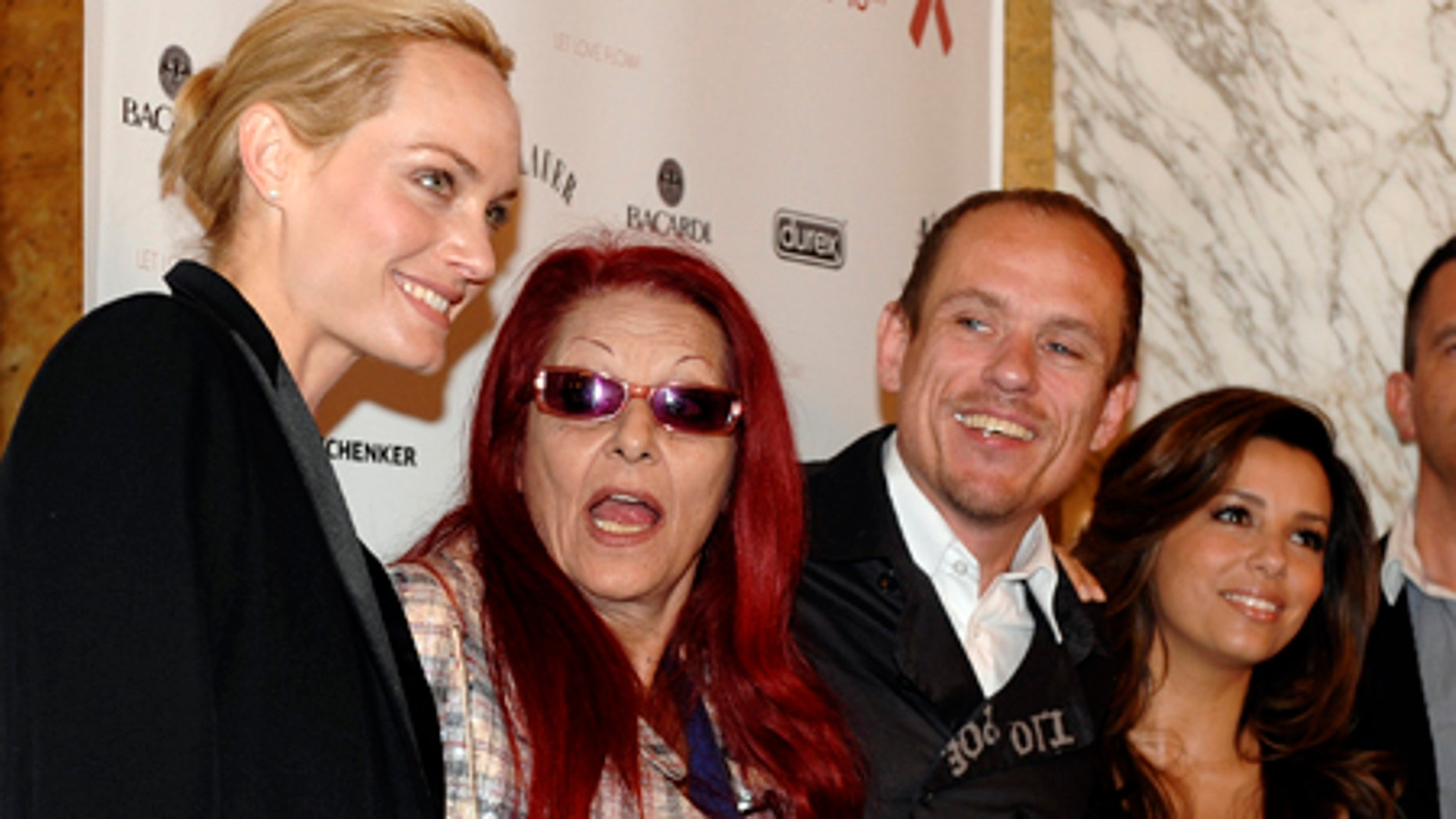 Actress Amber Valletta, designer Patricia Field, Life Ball organizer Gery Keszler and actress Eva Longoria, from left, pose for photographers at a news conference in Vienna, Saturday, May 16, 2009. They are in Vienna for the Austrian capital's annual Life Ball 09, a gay charity gala aimed at raising money for people with AIDS. (AP Photo/Hans Punz)