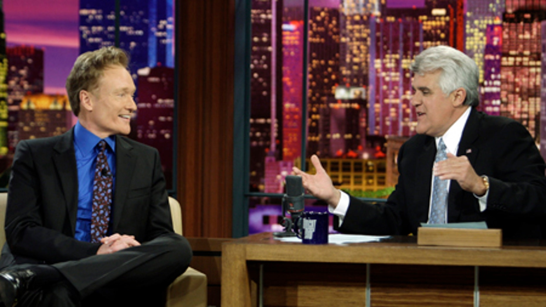 In this photo provided by NBC, Conan O'Brien interviewed by Jay Leno during Leno's final taping as host of The Tonight Show in Burbank, Calif. on Friday, May 29, 2009. (AP Photo/NBC, Paul Drinkwater) **MAGS OUT, NO ARCHIVING, NO SALES**