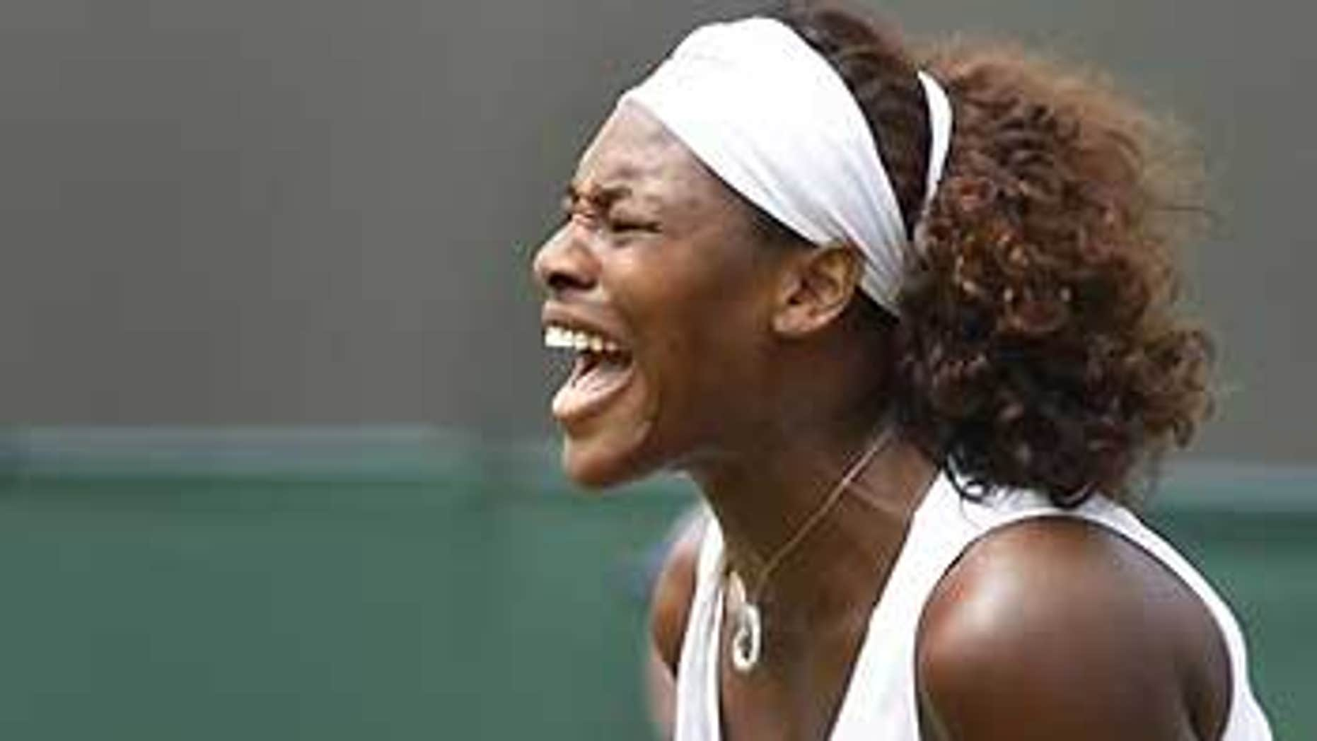 June 26: Serena Williams celebrates winning a point against Roberta Vinci of Italy during their third round singles match at Wimbledon, Friday.