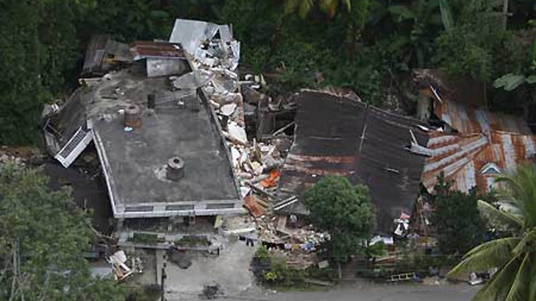 Oct. 3: Damaged houses are seen in this aerial image of an area affected by earthquake-triggered landslide in Padang Pariaman, West Sumatra.