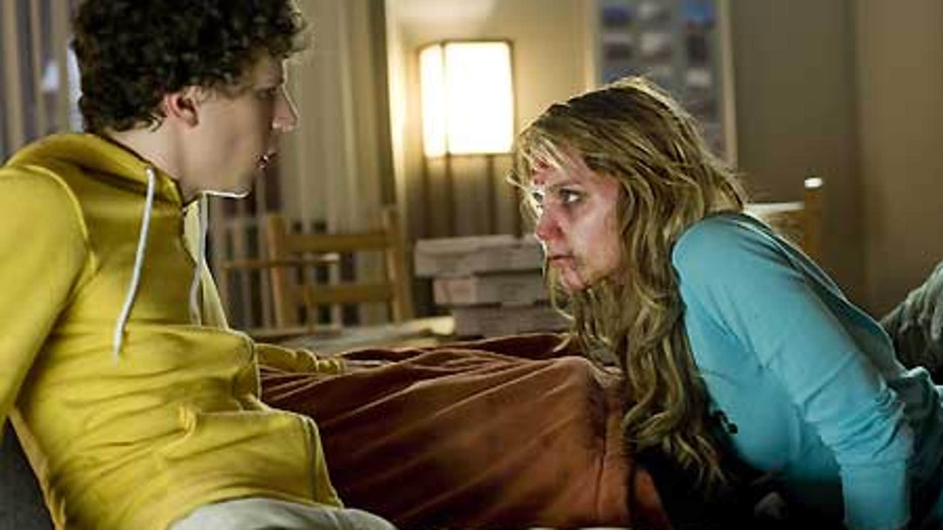 """In this film publicity image released by Columbia Pictures, Jesse Eisenberg, left, and Amber Heard are shown in a scene from, """"Zombieland."""""""