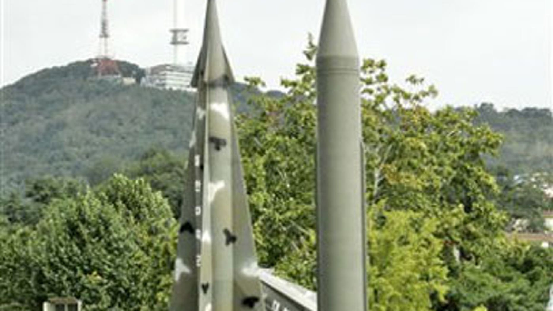 Oct. 8: A model of mock North Korea's Scud-B missile, center right in plain green, and other S. Korean missiles are displayed in Seoul, South Korea.
