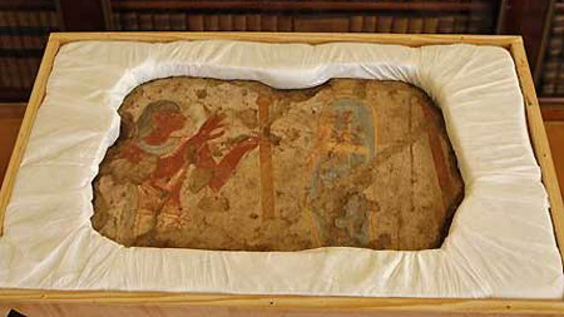 Dec. 14: One of the five fragments of an ancient wall painting that France returned to Egypt on Monday