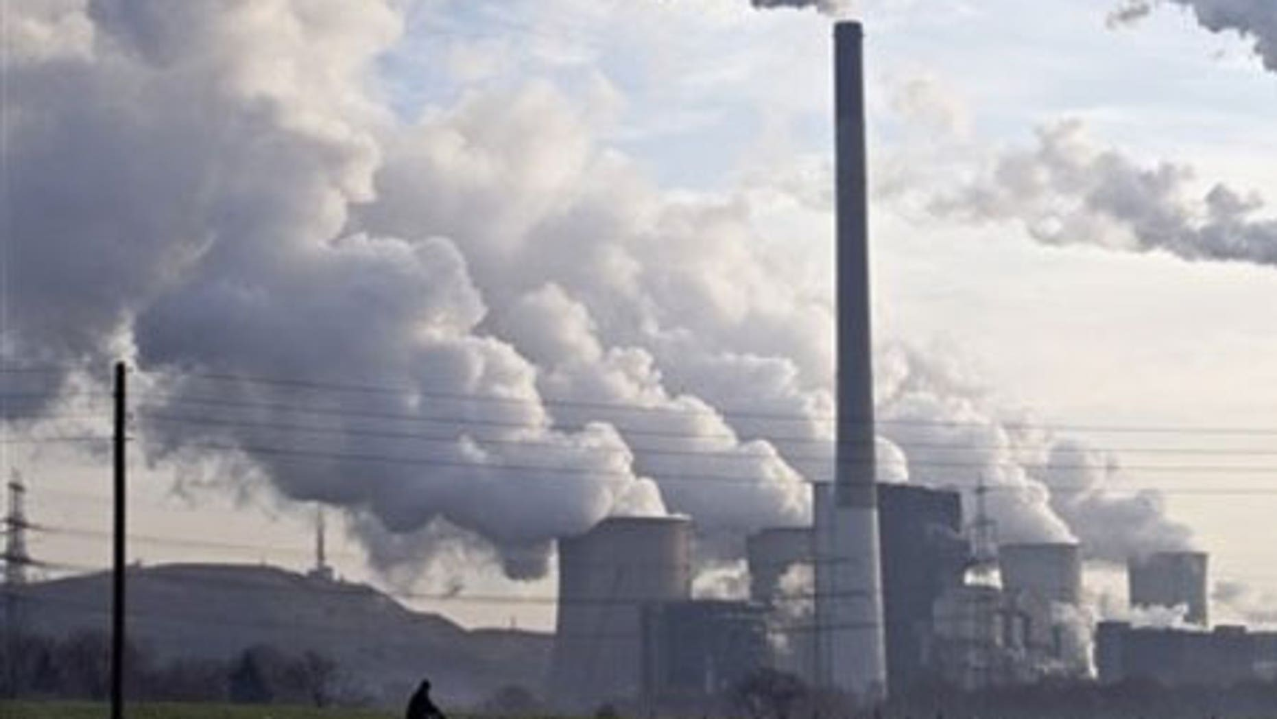 Dec. 16: Steam and smoke is seen over the coal burning power plant in Gelsenkirchen, Germany. Coal power plants are among the biggest producer of CO2.