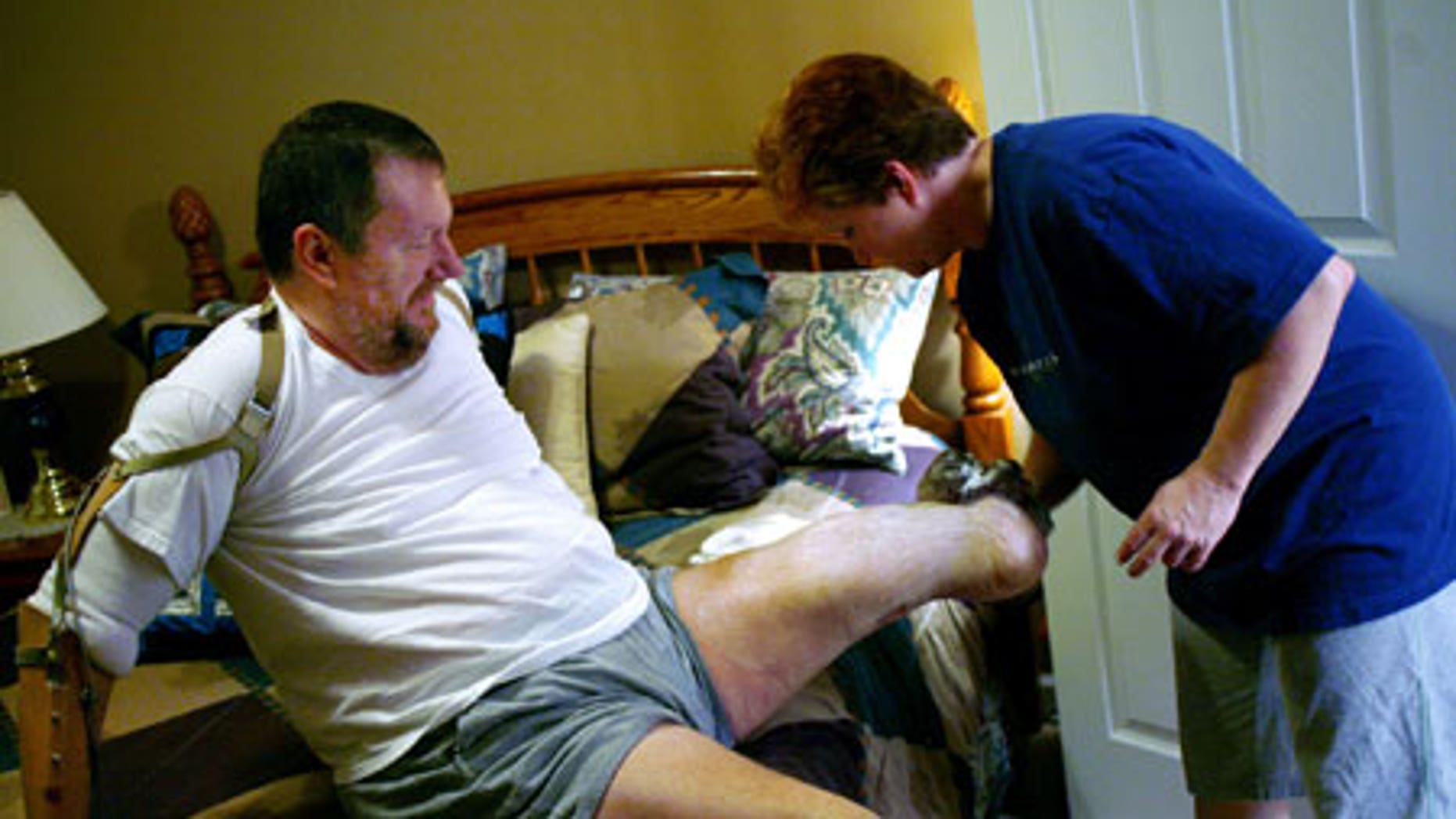 Feb. 4, 2009: Valarie Kepner washes her husband, Jeff Kepner's legs following a shower.