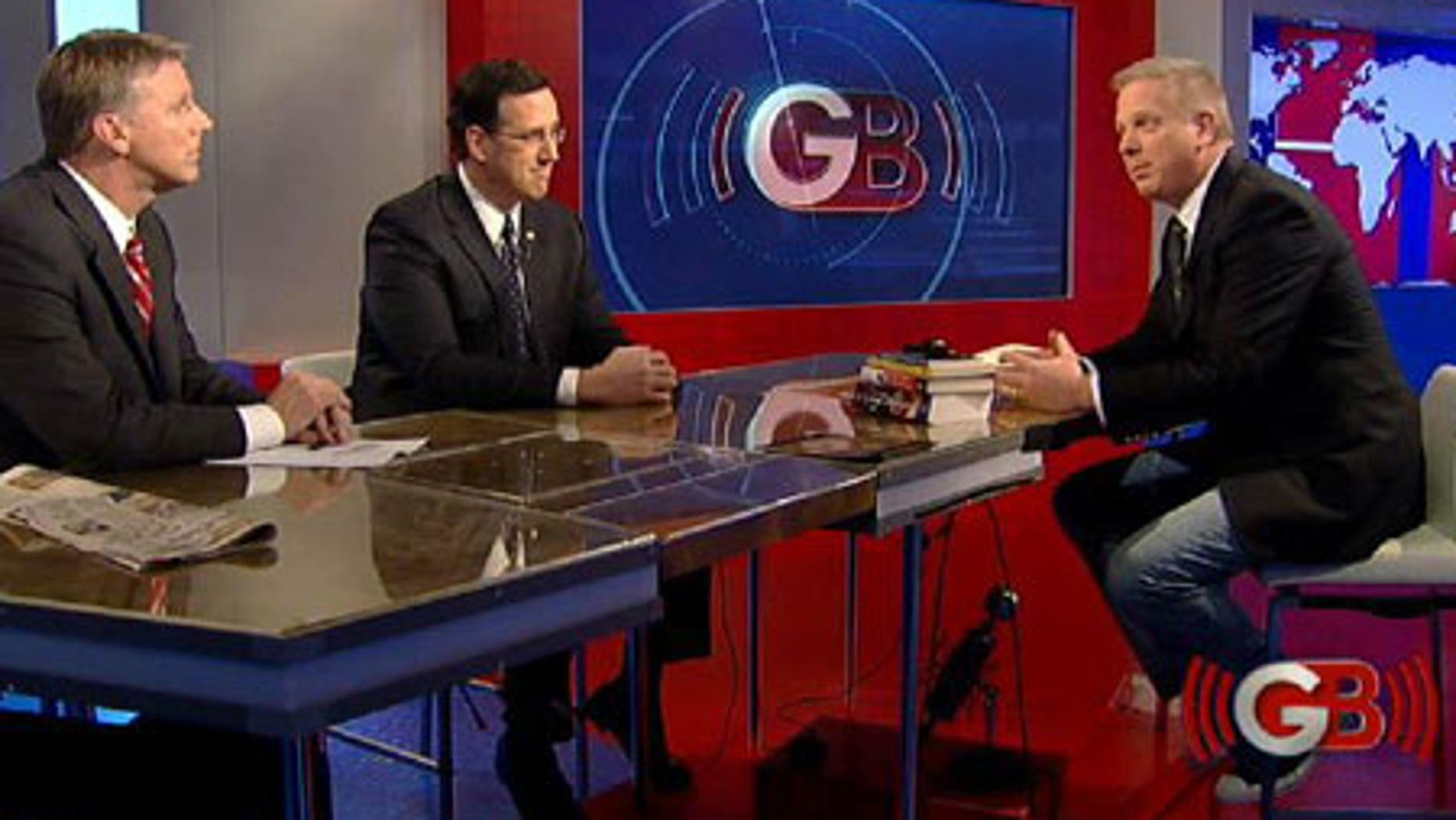 From left: Tim Cahill and Rick Santorum with Bret Baier