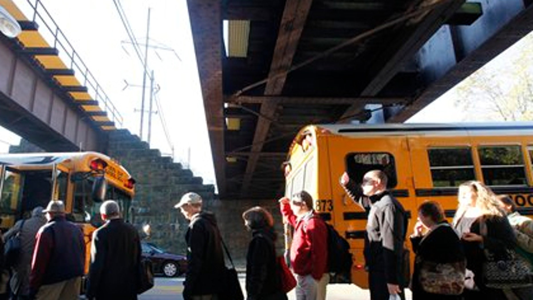 Nov. 4: Stranded commuters are loaded on buses near the scene of a train fire in Philadelphia.