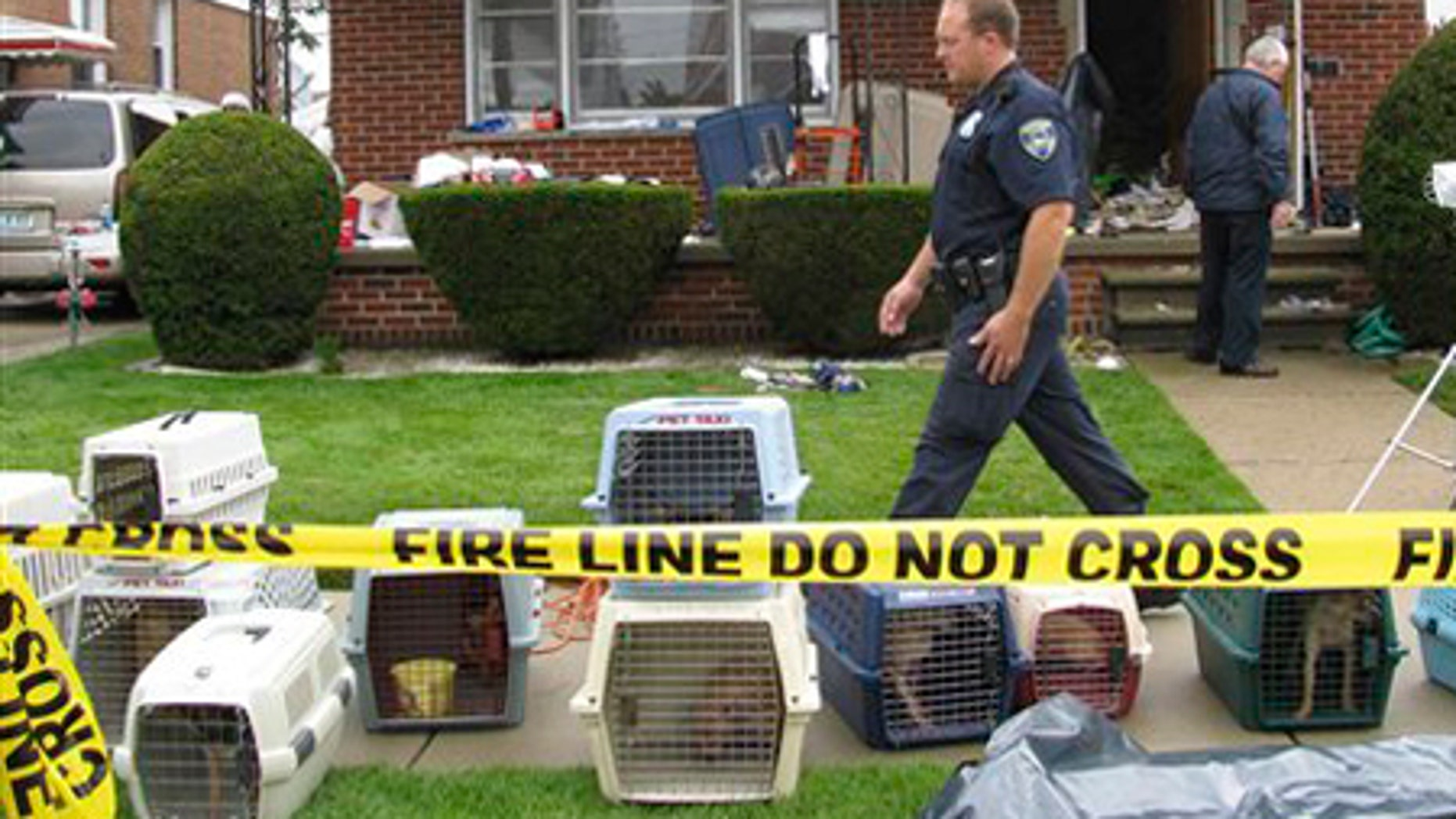 July 22: Law enforcement officials search a home in Dearborn, Mich.
