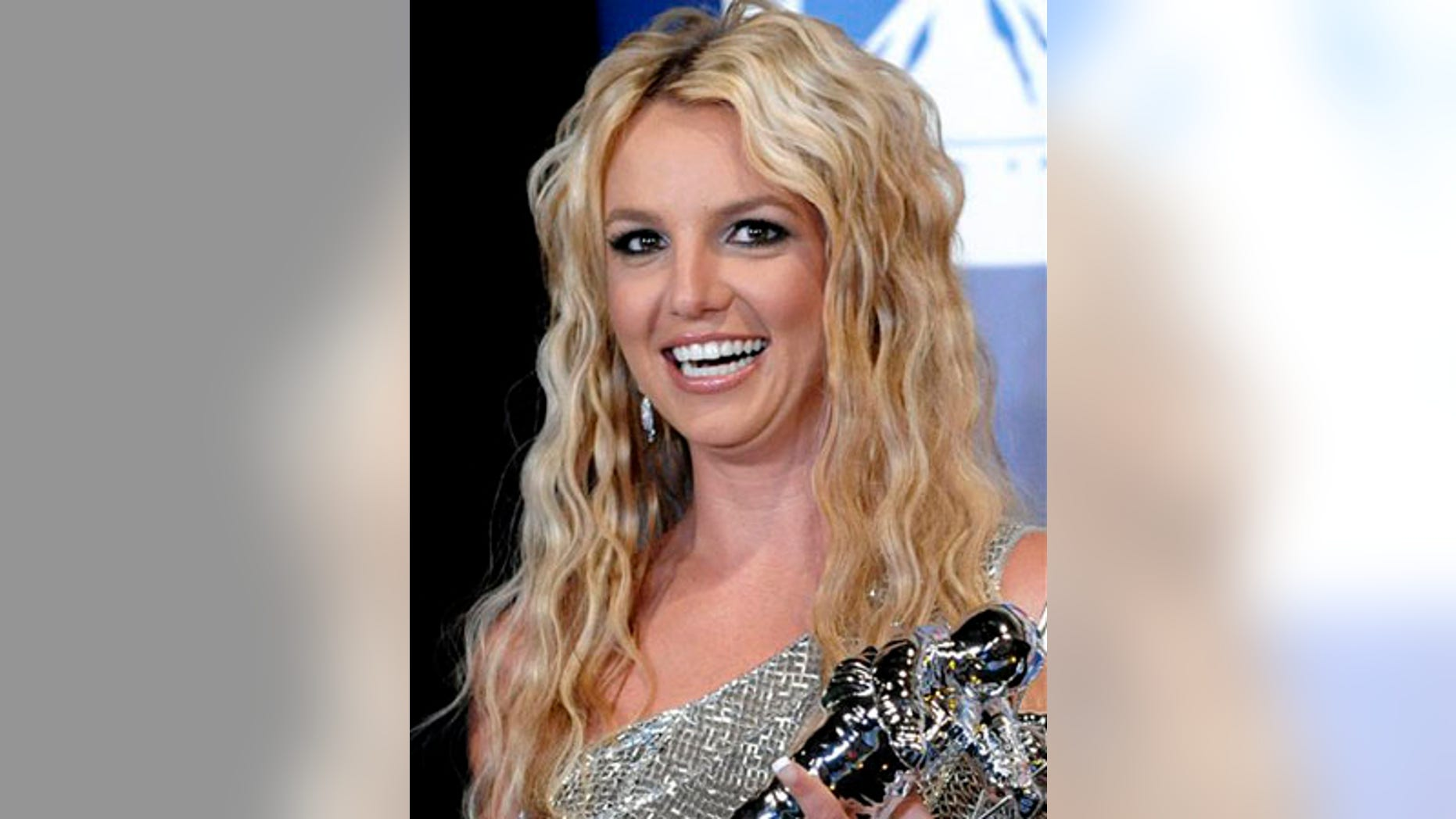 ** FILE ** In this Sept. 7, 2008 file photo, Britney Spears poses with her awards backstage at the 2008 MTV Video Music Awards in Los Angeles. (AP Photo/Chris Pizzello, file)