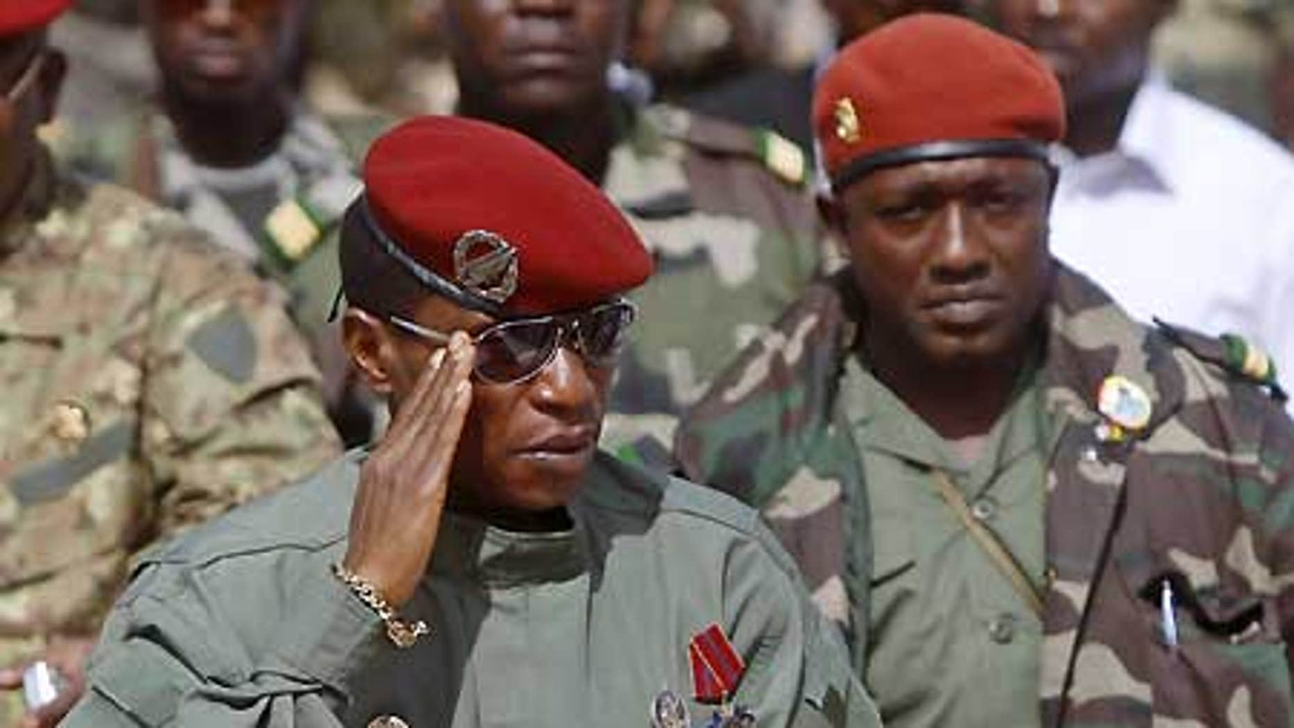 "Guinea's military leader, Capt. Moussa ""Dadis"" Camara, left, salutes next to presidential guard chief Abubakar ""Toumba"" Diakite, right."