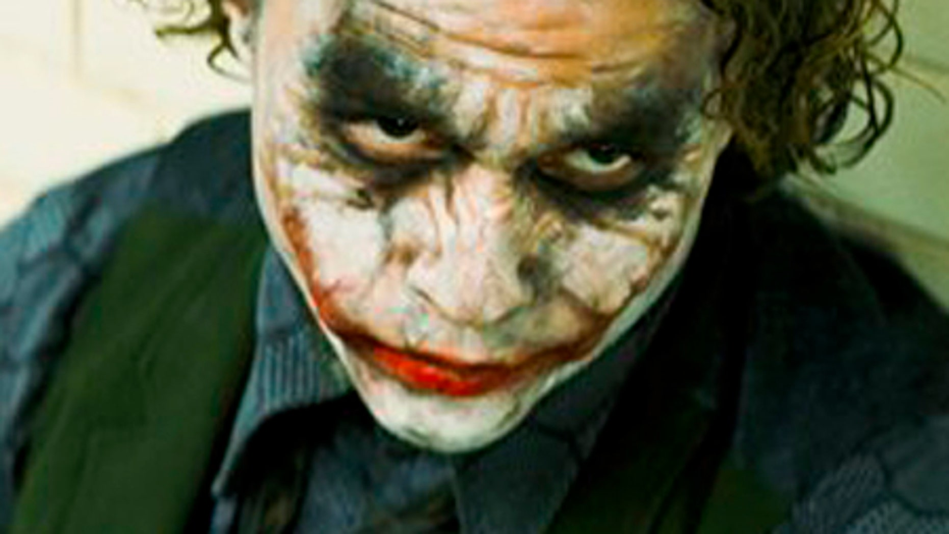 "In this image released by Warner Bros., Heath Ledger stars as The Joker in ""The Dark Knight.""  Ledger is an overwhelming favorite to become, on Sunday, only the second actor to win a posthumous Oscar. If he does, the words ""Oscar-winning actor"" will doubtless precede each mention of his name forever. But beyond that, what will his legacy be? (AP Photo/Warner Bros. Pictures) ** NO SALES **"