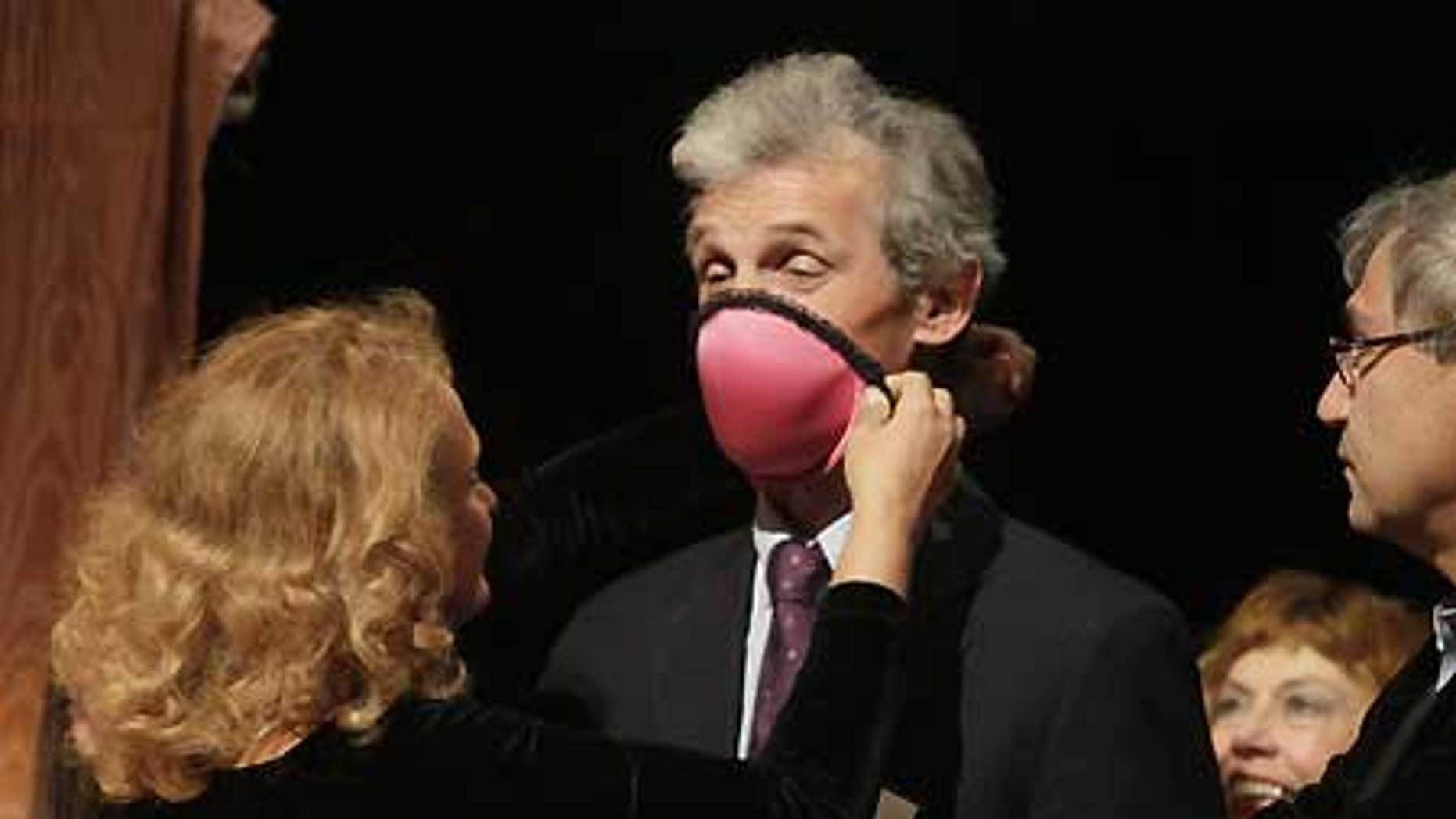 Dr. Elena Bodnar, left, took home the 2009 Ig Nobel Public Health Prize for designing a bra that can be converted into two gas masks.