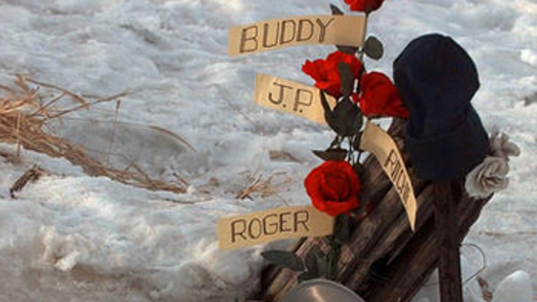 """**FILE** Flowers adourn a memorial Feb. 6, 1999, at the spot where the plane carrying Buddy Holly, Ritchie Valens, J.P. """"The Big Bopper"""" Richardson and their pilot Roger Peterson crashed, killing all aboard Feb. 3, 1959, near Clear Lake, Iowa. The son of """"The Big Bopper,"""" Jay Richardson, has hired a forensic anthropologist to answer questions about how his father died in the 1959 plane crash along with rock 'n' rollers Holly and Valens. (AP Photo/Rodney White, File)"""