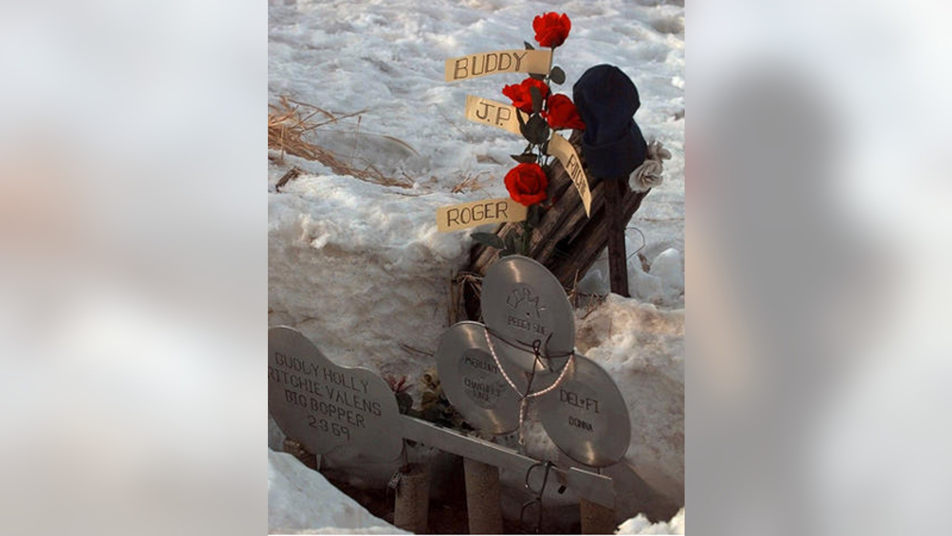 """Feb. 6, 1999: A memorial is set up where Buddy Holly, Ritchie Valens, and J.P. """"The Big Bopper"""" Richardson, died in a plane crash in Clear Lake, Iowa."""