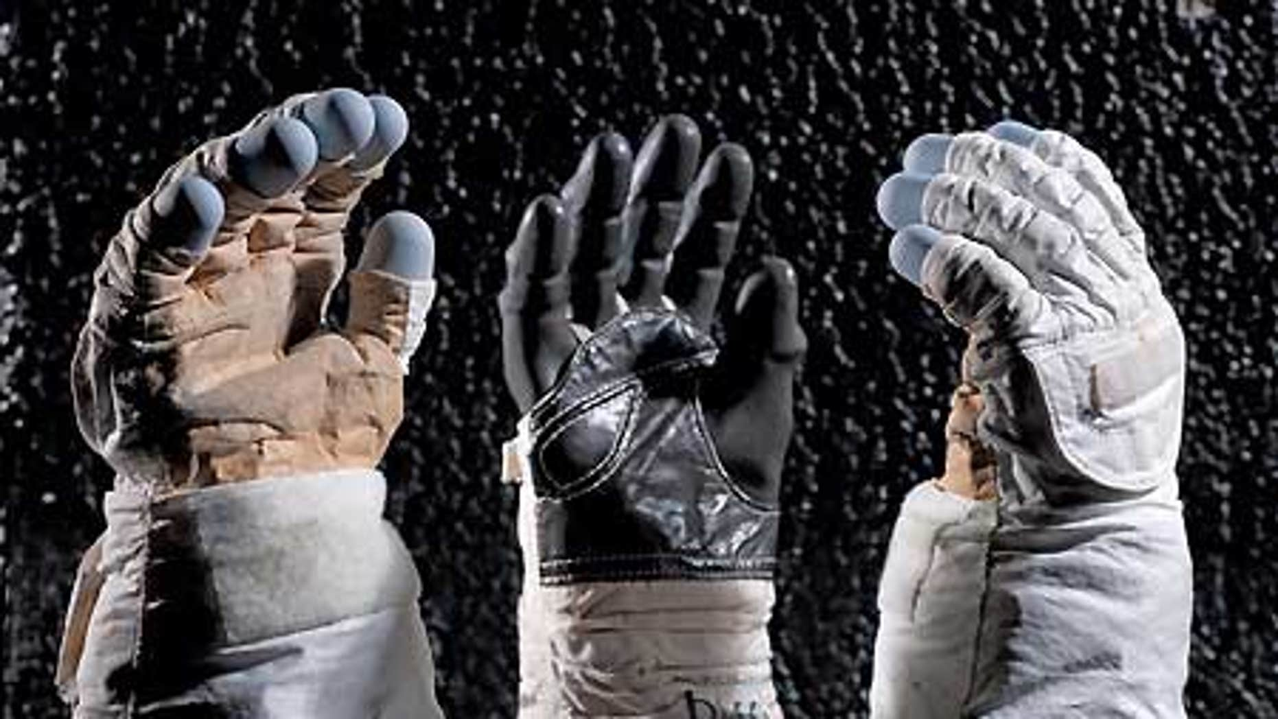 Spacewalk gloves and a Sokol pressure-suit glove are on display in the 'Moving Beyond Earth' exhibition