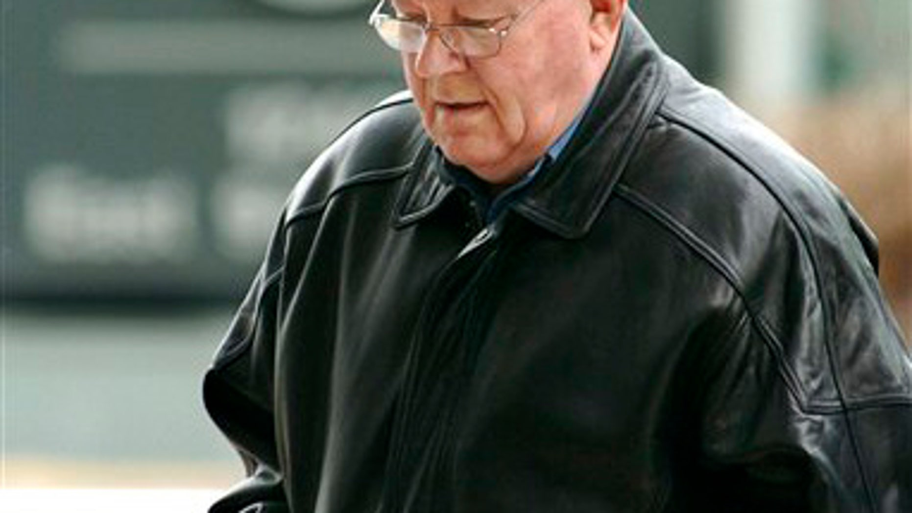 Feb. 28, 2005: Accused Nazi death camp guard John Demjanjuk arrives at the federal building in Cleveland.