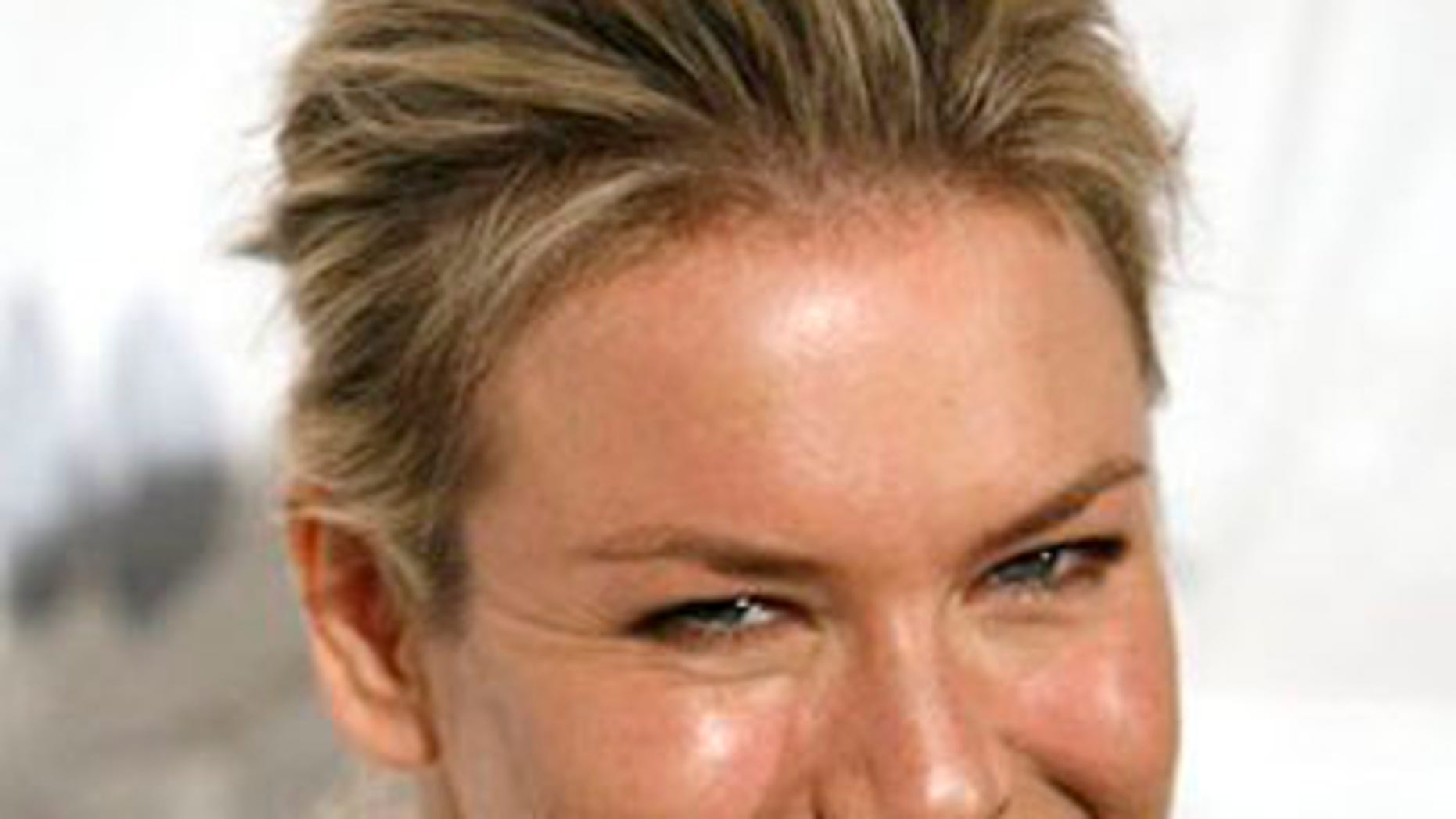 ** FILE ** In this Oct. 16, 2008 file photo, actress Renee Zellweger arrives at the International Women's Media Foundation's Courage in Journalism Awards in Beverly Hills, Calif. (AP Photo/Gus Ruelas, file)