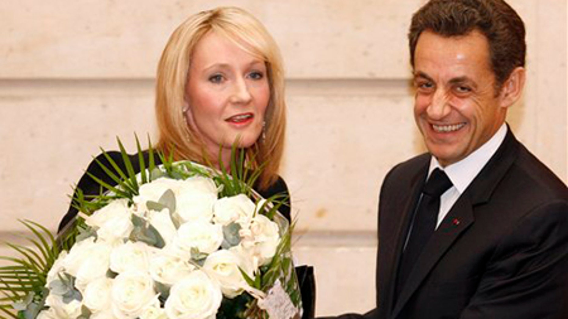 Feb. 3: British writer J.K. Rowling, left, receives a bouquet from French President Nicolas Sarkozy during a ceremony at the Elysee Palace in Paris.