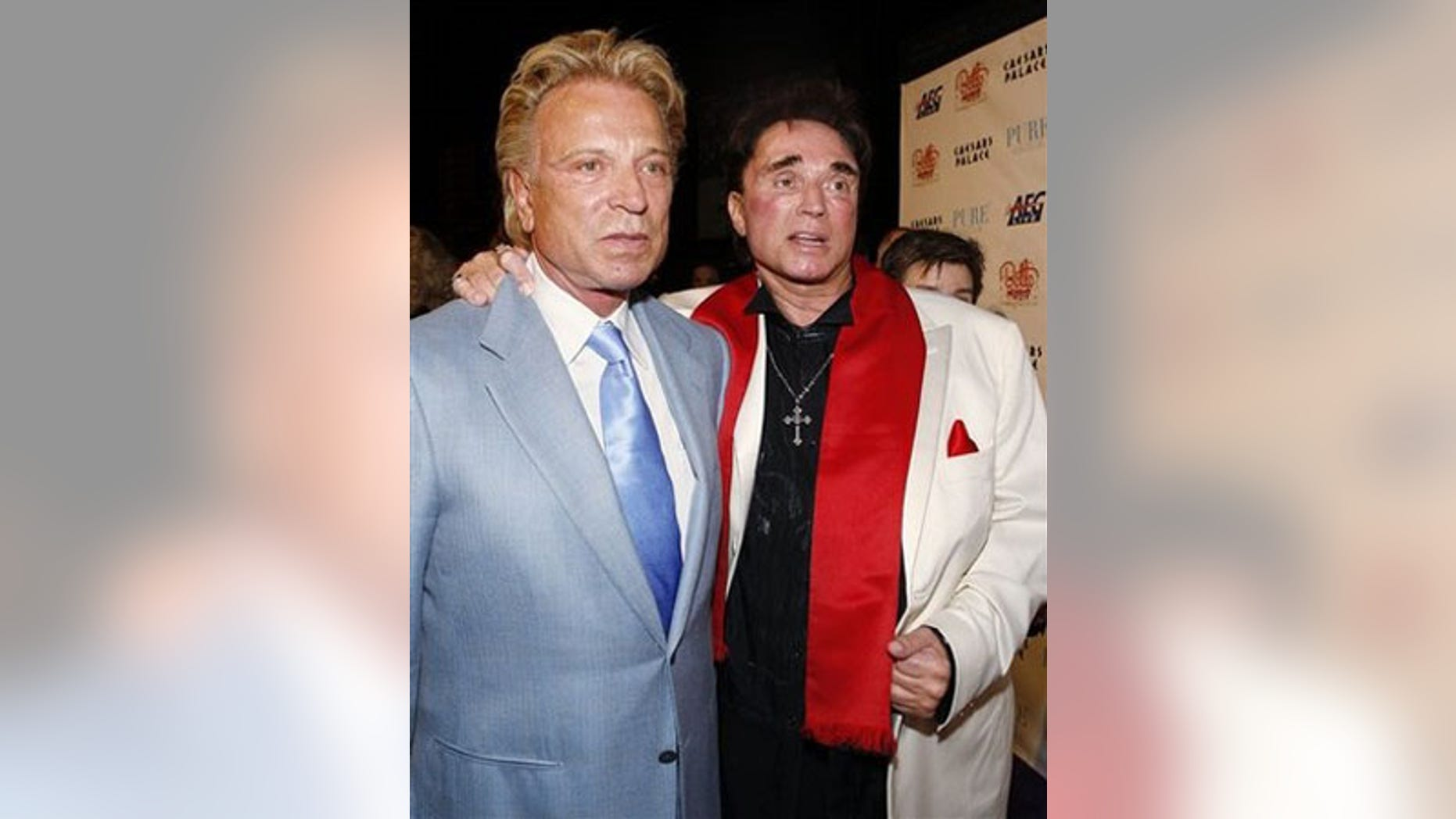 """** FILE ** In this Feb. 20, 2008 file photo, Siegfried Fischbacher, left, and Roy Horn arrive at a party following the premiere performance of Bette Midler's """"The Showgirl Must Go On"""" at Caesar's Palace hotel and casino in Las Vegas. (AP Photo/Isaac Brekken, file)"""