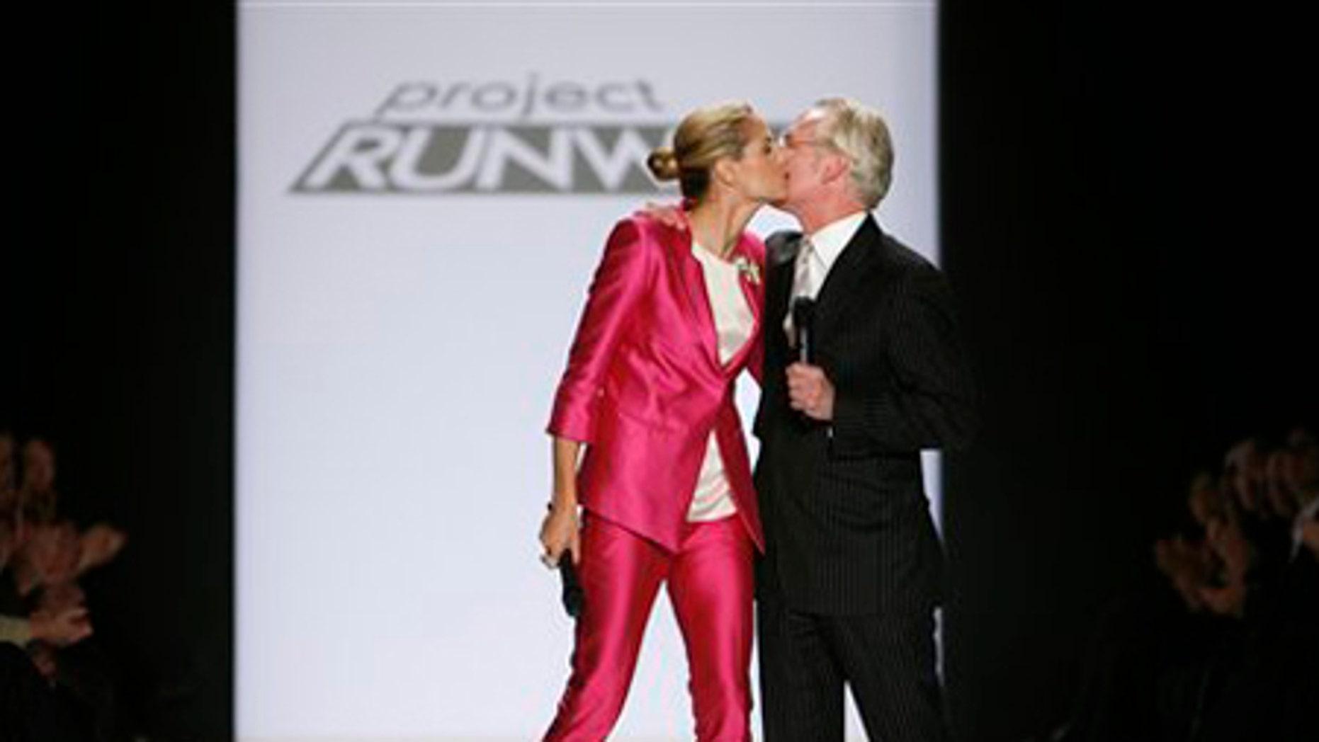 Heidi Klum and Tim Gunn kiss after the Project Runway Season 6 Finale show during Fashion Week Friday, Feb. 20, 2009 in New York.  (AP Photo/Jason DeCrow)