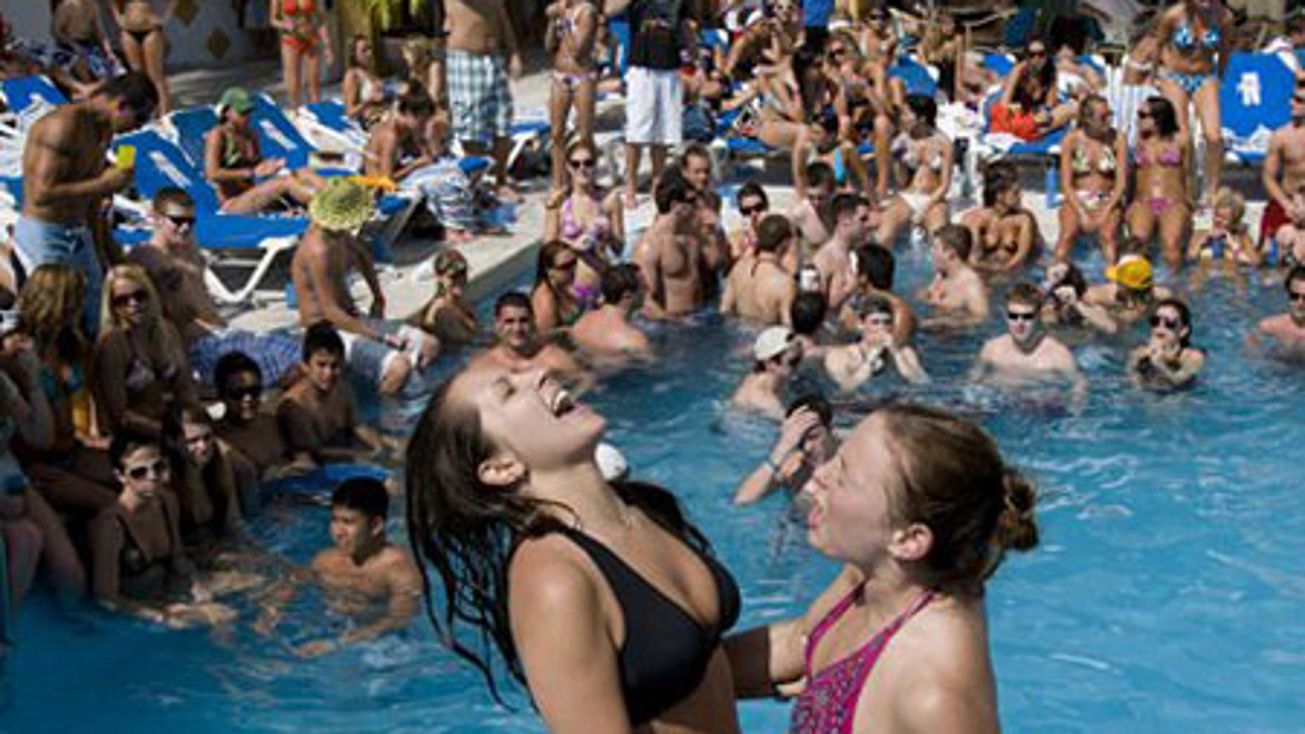 In this Feb. 27, 2008 file photo two U.S students dance in a hotel pool in Acapulco, Mexico.