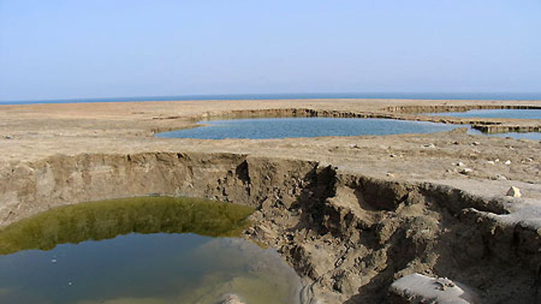 Sinkholes at the Dead Sea's Mineral Beach, in the West Bank, in February 2005.