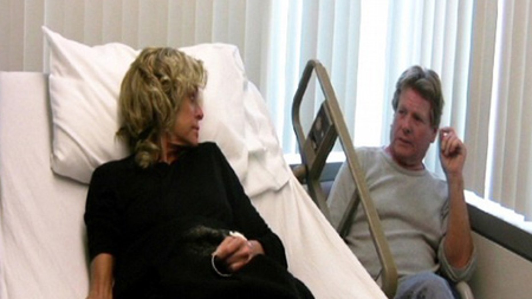 Farrah Fawcett and Ryan O'Neal are shown in this publicity photo from the video diary 'Farrah's Story.'