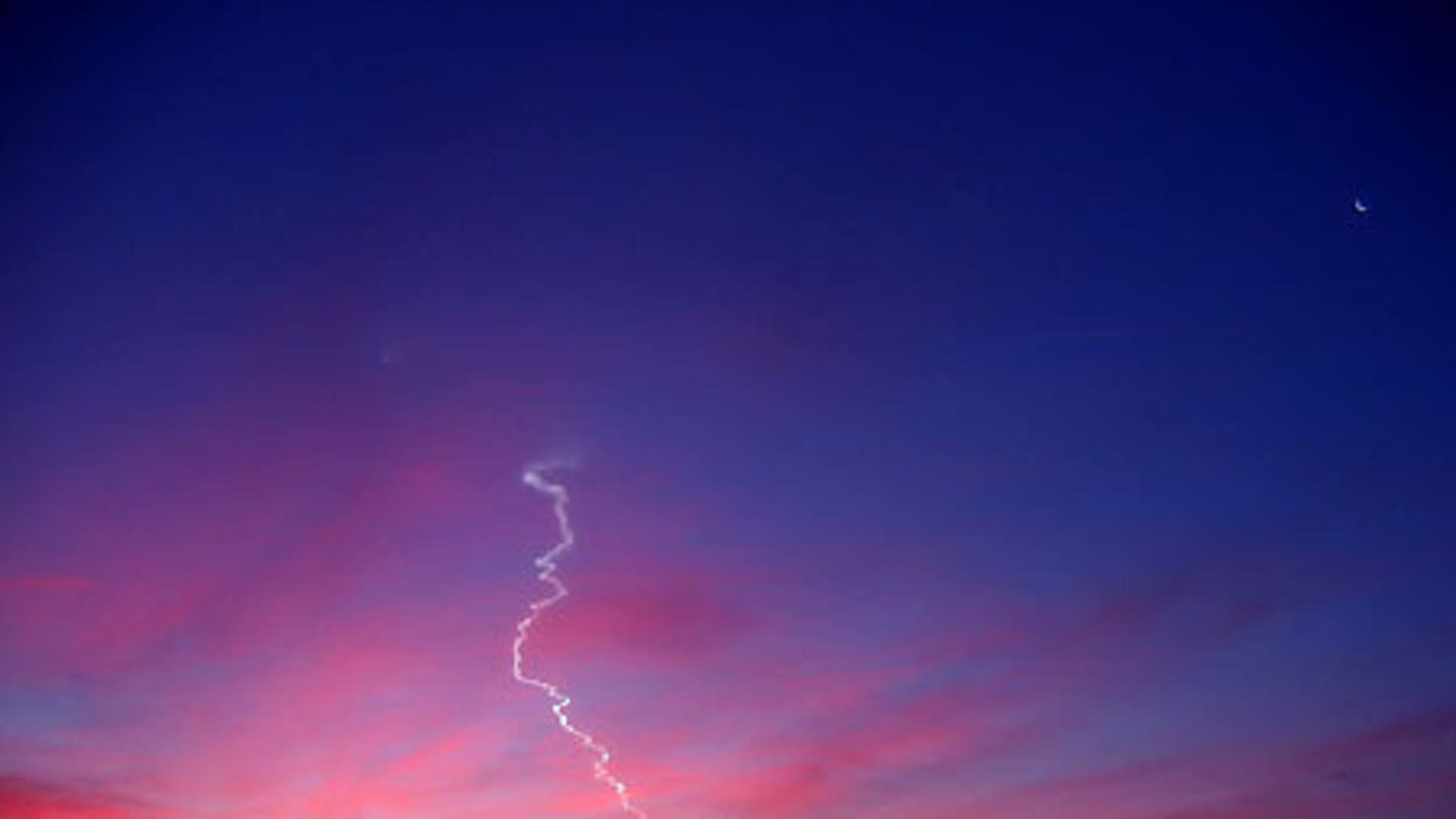 A Dec. 2006 Minotaur rocket launch from Wallops Island, Va., as photographed by Geoff Chester in Alexandria, Va.