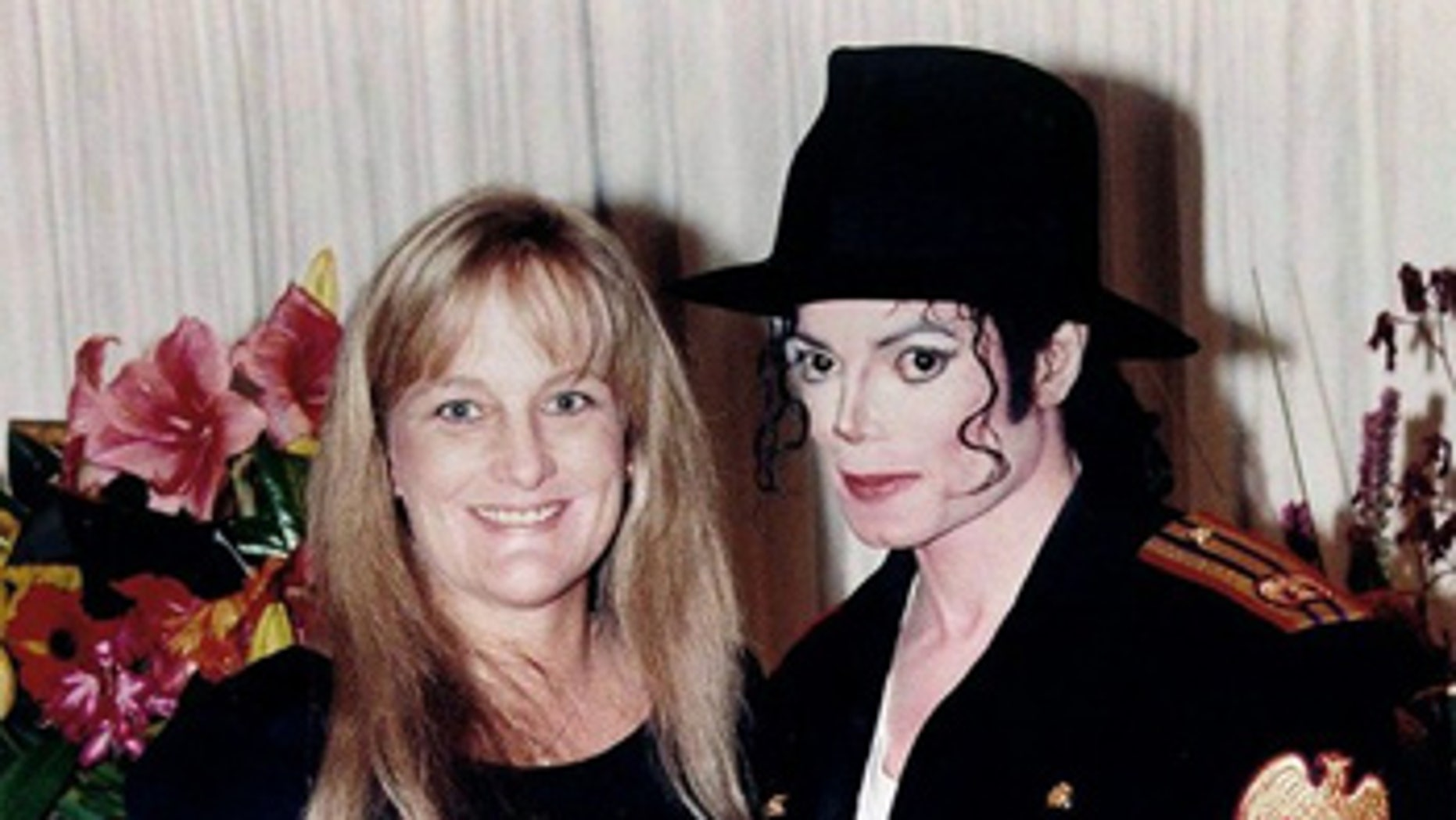November 14, 1996: Pop star Michael Jackson and his new wife Debbie Rowe pose for a wedding photo minutes after the ceremony in California.