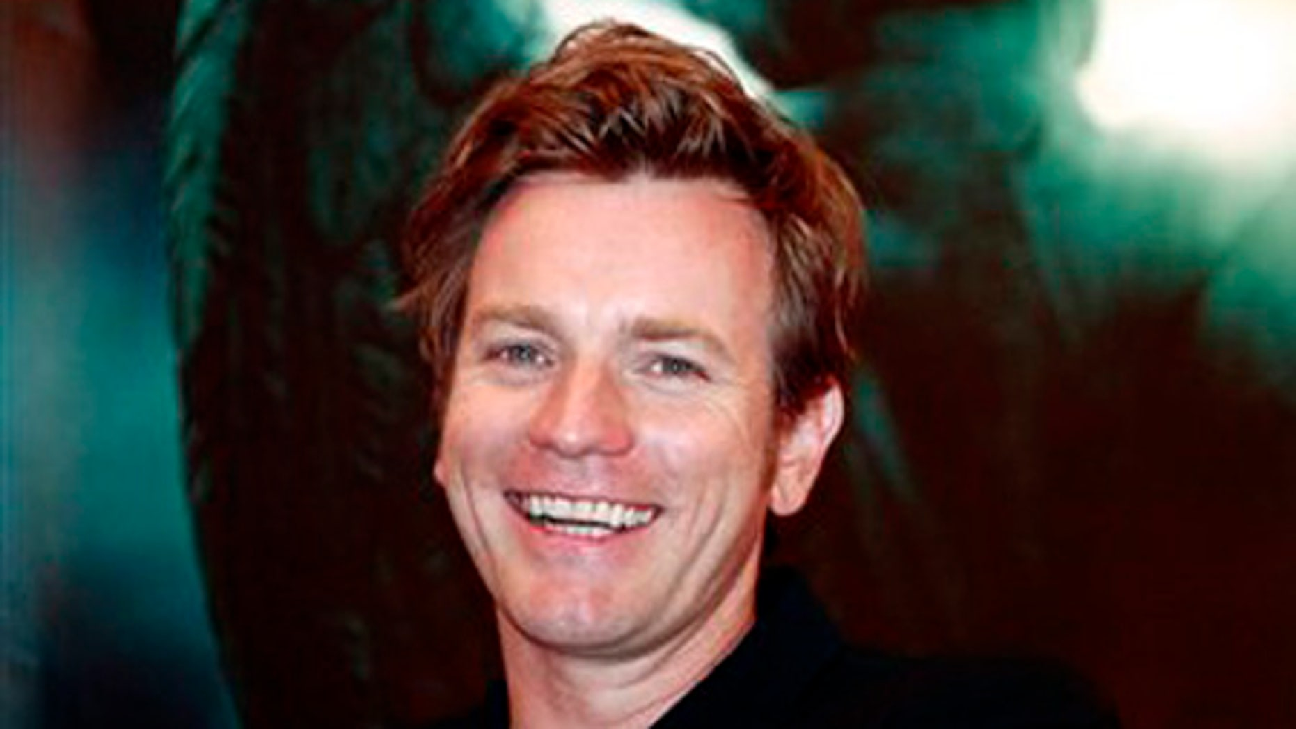 """British actor Ewan McGregor smiles during a press conference of U.S. movie Angels and Demons as part of the 12th Shanghai International Film Festival Sunday June 21, 2009 in Shanghai, China. Actor Ewan McGregor says the Vatican's criticism of the religious thriller """"Angels and Demons"""" was muted compared to the previous Robert Langdon adventure """"The Da Vinci Code"""" because the newer film doesn't challenge the Catholic faith. (AP Photo/Eugene Hoshiko)"""