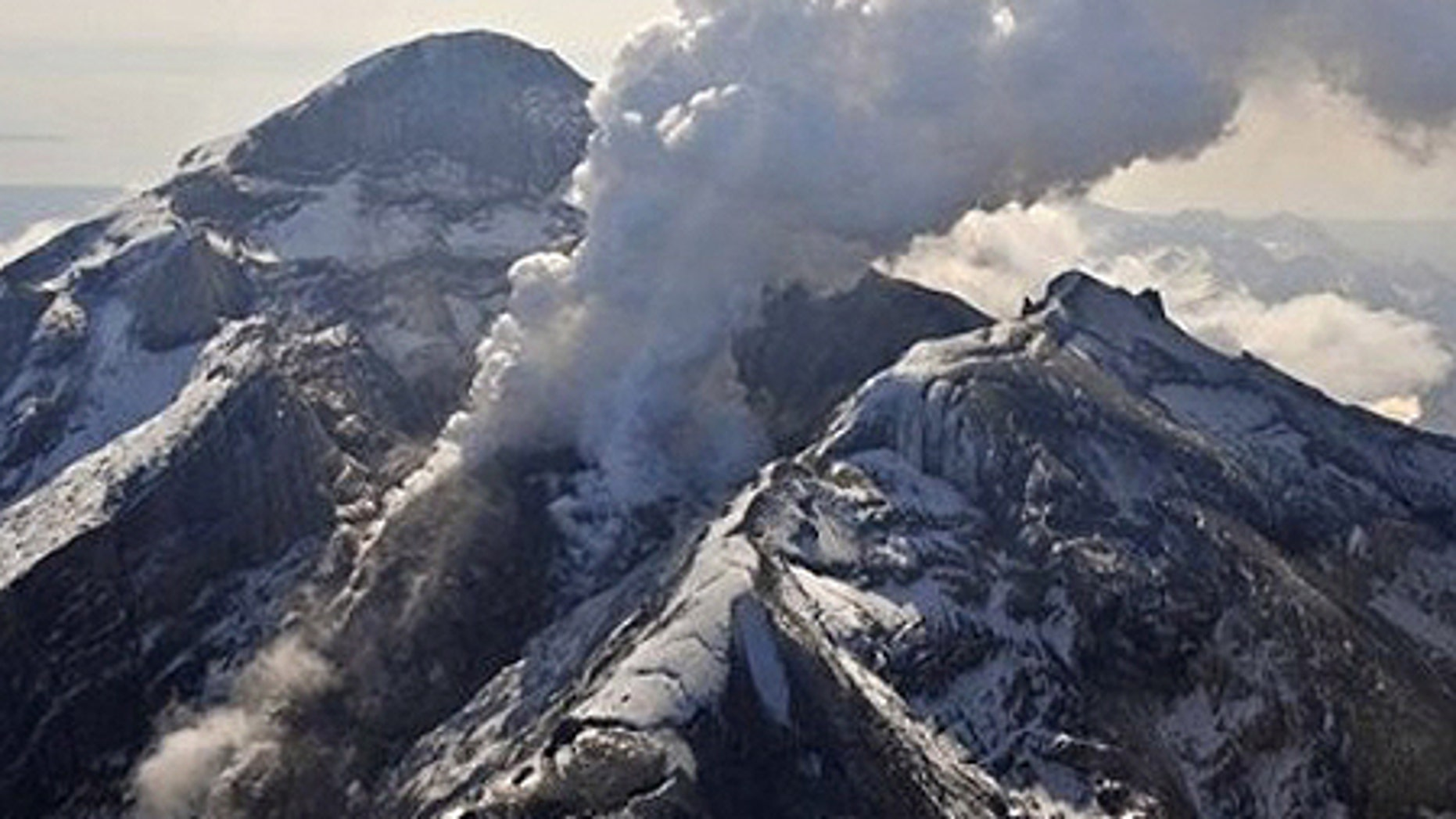 In this May 8, 2009 photo provided by the Alaska Volcano Observatory, the summit crater, active lava dome, and steam plume of the Mount Redoubt volcano, located about 100 miles southwest of Anchorage, are shown. Mount Redoubt hasn't had a major eruptive event in more than a month but scientists say that could soon change. (AP Photo/Alaska Volcano Observatory, USGS, Chris Waythomas)