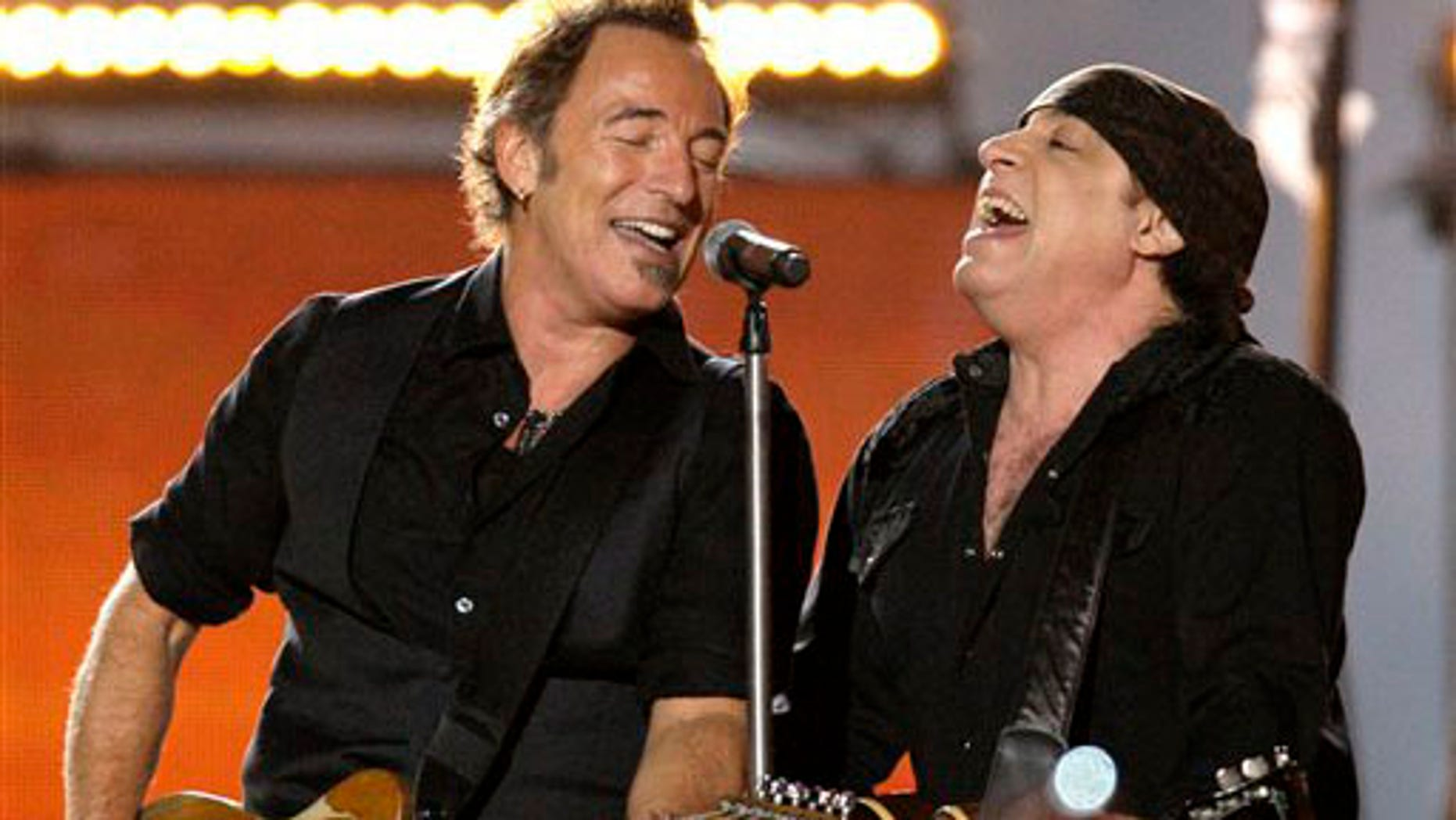 ** FILE ** In this Feb. 1, 2009 file photo, Bruce Springsteen, left, and Steven Van Zandt, of Bruce Springsteen and the E Street Band, perform at halftime at the NFL Super Bowl XLIII football game between the Arizona Cardinals and Pittsburgh Steelers in Tampa, Fla. (AP Photo/Winslow Townson, file)