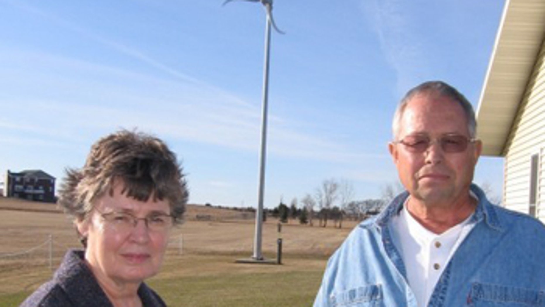 Jeanne and Larry Walth, of Wishek, N.D., save roughly $50 monthly using the wind turbine city officials say must come down.