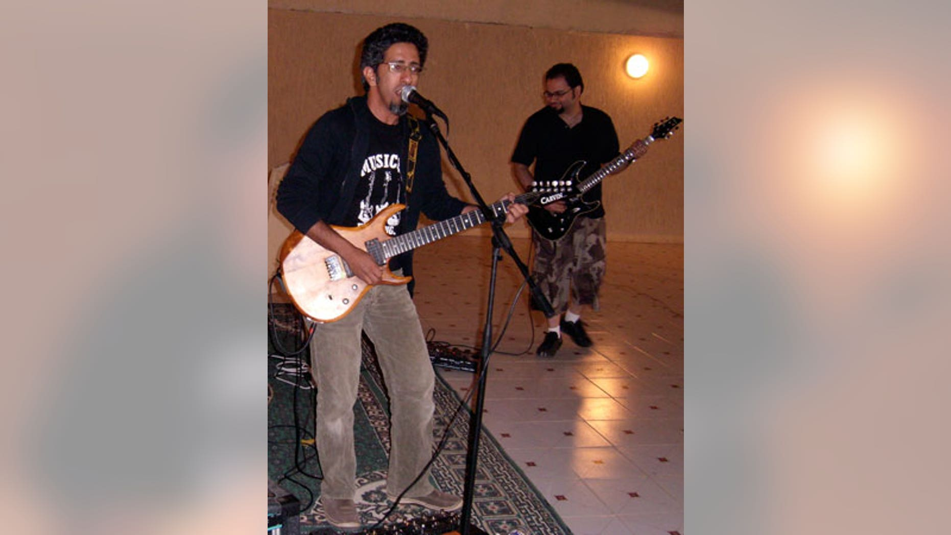 Saudi rock musician and journalist Hasan Hatrash, left, must contend with the unwelcome attention of Saudi Arabia's religious police, which frowns on Western-style music and dress.