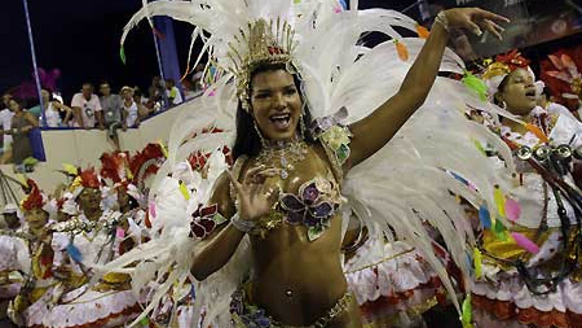 Feb. 24: Juliane Almeida, queen of the drums' section of Viradouro samba school dances during carnival parade at the sambodrome, in Rio de Janeiro.