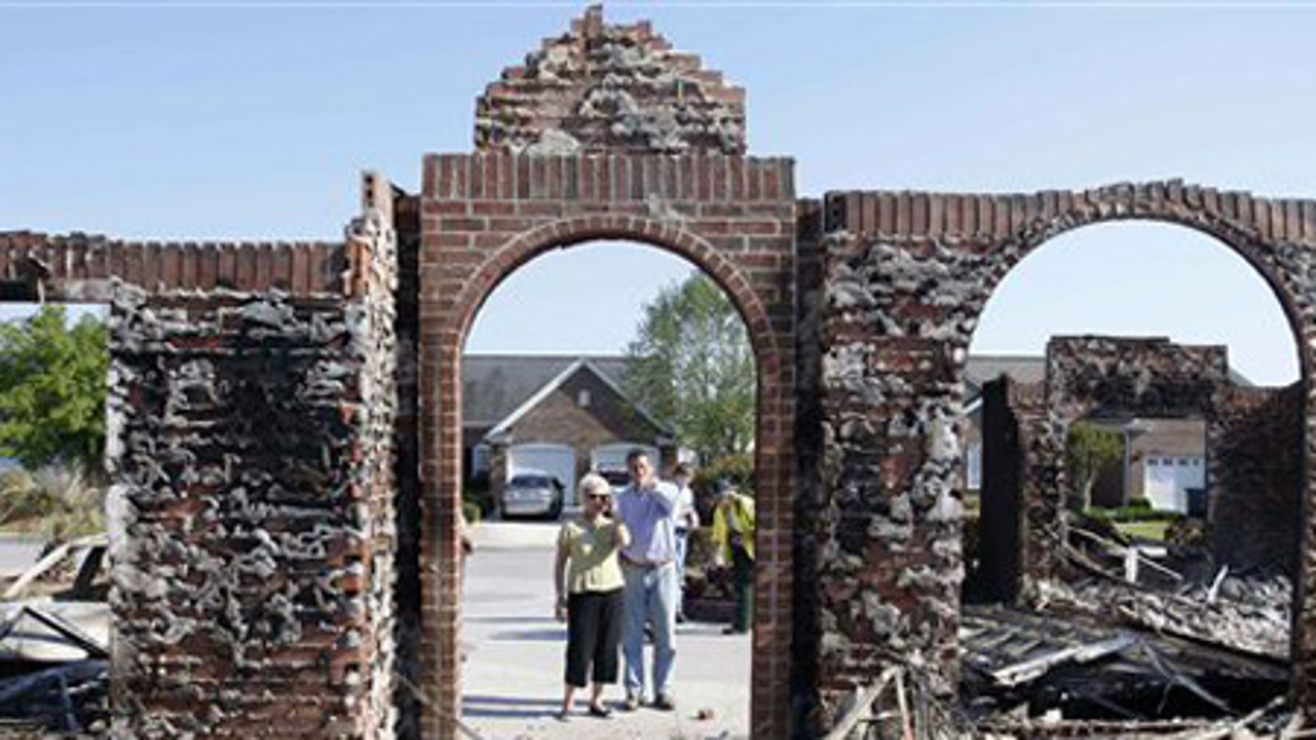 April 24: South Carolina Gov, Mark Sanford, right, is guided through the destruction caused by the wildfire in the Barefoot Resort.