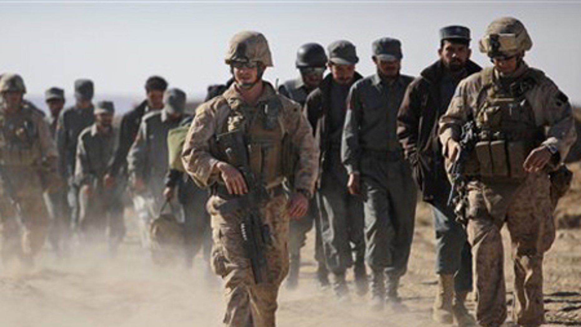 Dec. 5: U.S. Marines escort new Afghan National Police officers to their base in Khan Neshin in the province of Helmand, southern Afghanistan.