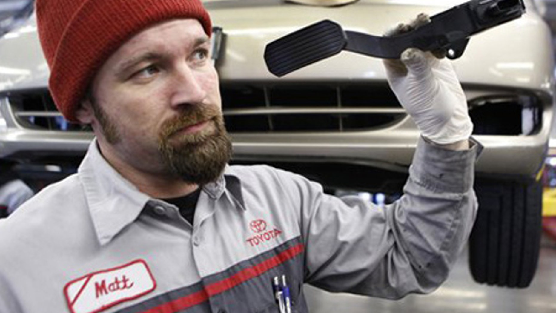 Feb. 3: Mechanic Matthew Lee holds a recalled Toyota gas pedal at a Toyota dealership in Palo Alto, Calif.
