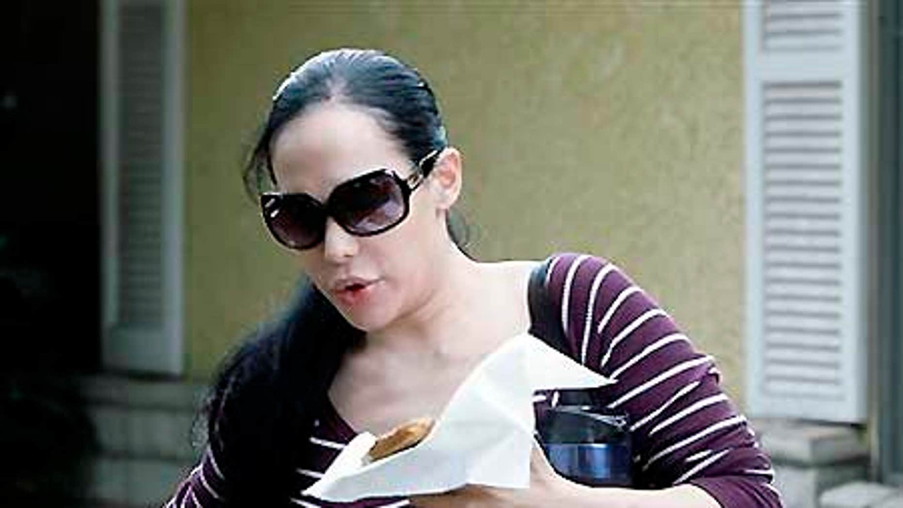 Nadya Suleman, the mother of octuplets leaves her home in Whittier, Calif.