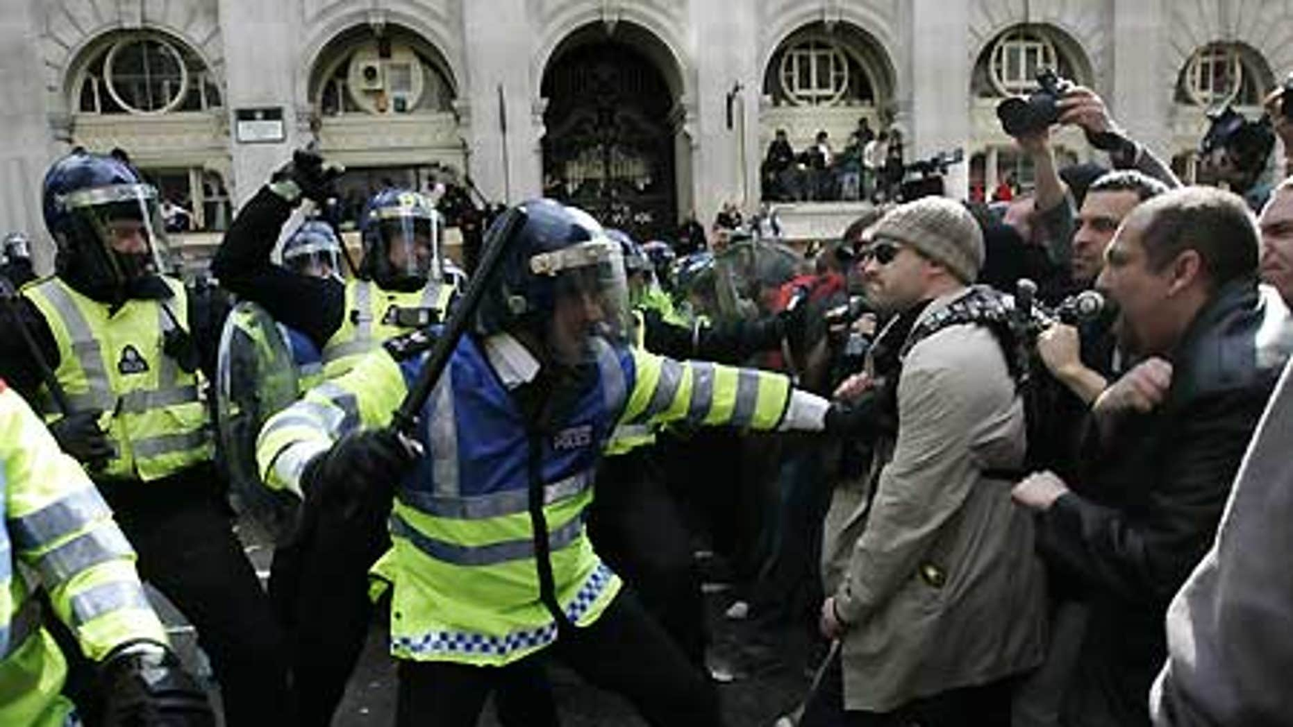 April 1: British police in riot gear, left, and protesters are seen during clashes in central London's financial district.