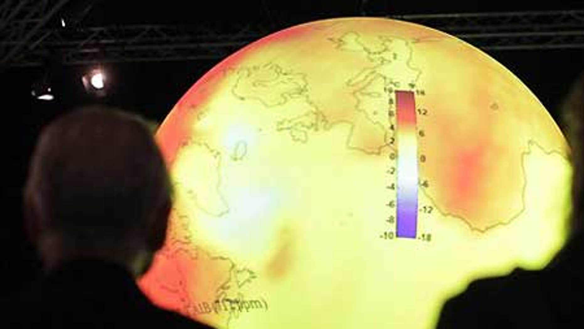 Dec. 8: Delegates look at a giant balloon displaying the warming of the world's oceans at the U.S. center at the U.N. Climate Summit in Copenhagen.