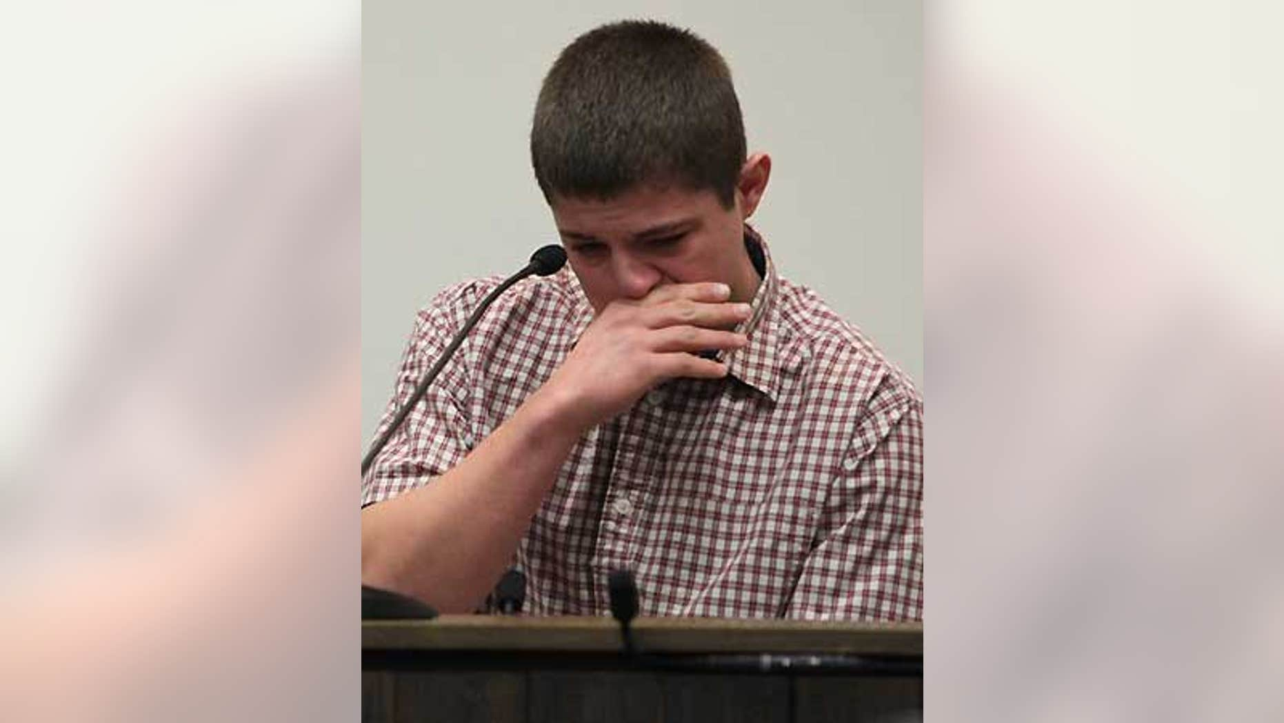 Feb. 12: Brandon Simkins cries at the Butler County Courthouse in Allison, Iowa as he recalls Mark Becker pulling a gun on him.