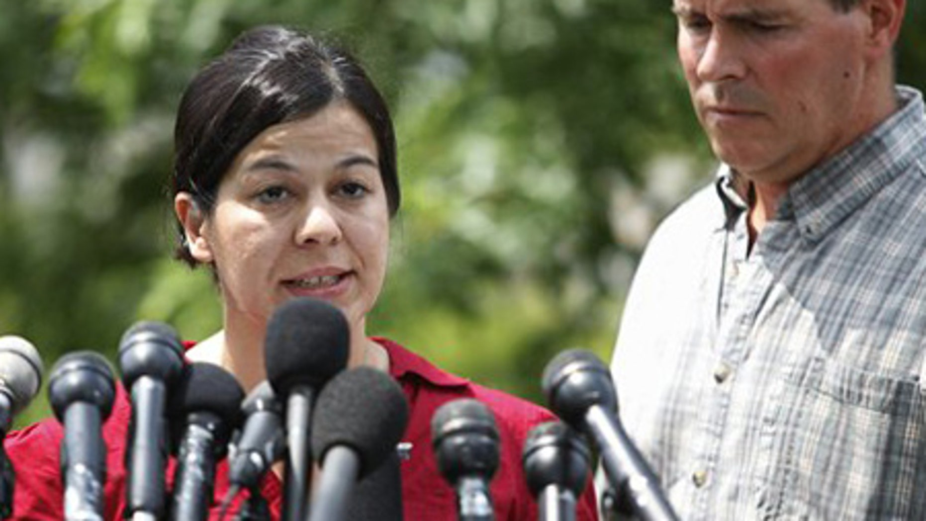 July 29: Lucia Whalen speaks during a media availability in Cambridge, Mass., alongside her husband.