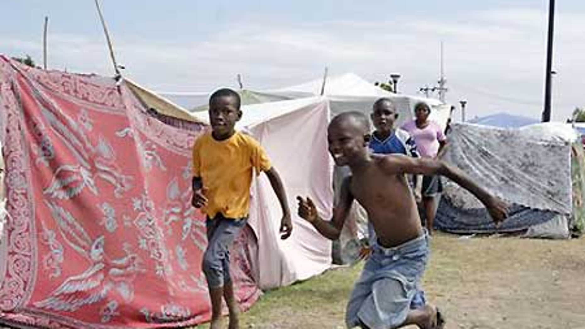 Jan. 26: Boys play in a tent city called Mais Gate near Port au Prince airport.