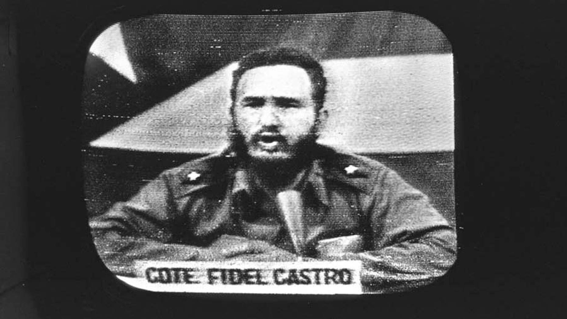 """This two picture combination shows, above: in a Oct. 23, 1962 file photo, Cuban Prime Minister Fidel Castro replies to President Kennedy's naval blockade over Cuban radio and television as seen on a television monitor at Key West, Fla.; and below, in a Aug. 9, 2010 file photo, a man walks past souvenir plates featuring Mao Zedong, the founder of the People's Republic of China, right, and an emblem of Kuomintang (National People's Party) that fought Mao's forces in a civil war, at an antique market Monday, in Shanghai. The many long, strange trips that began in 1960 and led, today, to what we know as """"the 1960s"""" can be looked at through several perspectives. One journey begins with the Cuban missile crisis, anti-Communist paranoia and militant radicalism, and emerges as Chairman Mao coffee mugs and Che Guevara T-shirts on sale at the mall. (AP Photos/File, Eugene Hoshiko)"""