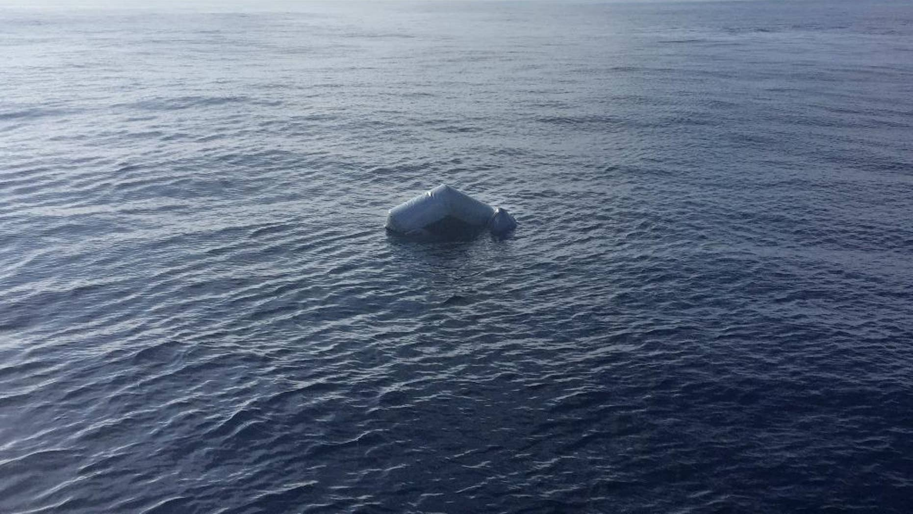 In this photo released by Proactiva Open Arms NGO on Friday, March 24, 2017 an upturned rubber boat floats in the Mediterranean Sea off the Libyan coast, during a search and rescue operation by Spanish NGO Proactiva Open Arms. A Spanish aid organization says it fears hundreds of migrants may have died off the coast of Libya after five bodies were found near two capsized boats and the search for a third vessel reported missing had so far proved futile. (Proactiva Open Arms via AP)