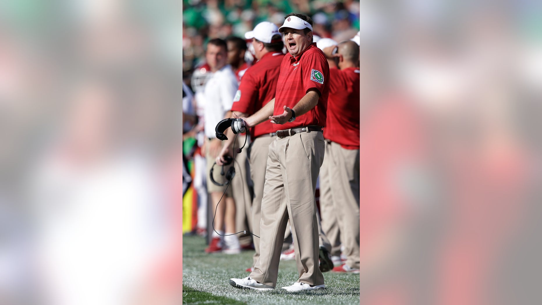 Oklahoma head coach Bob Stoops questions a call during the first half of an NCAA college football game against Notre Dame, Saturday, Sept. 28, 2013, in South Bend, Ind. (AP Photo/Darron Cummings)