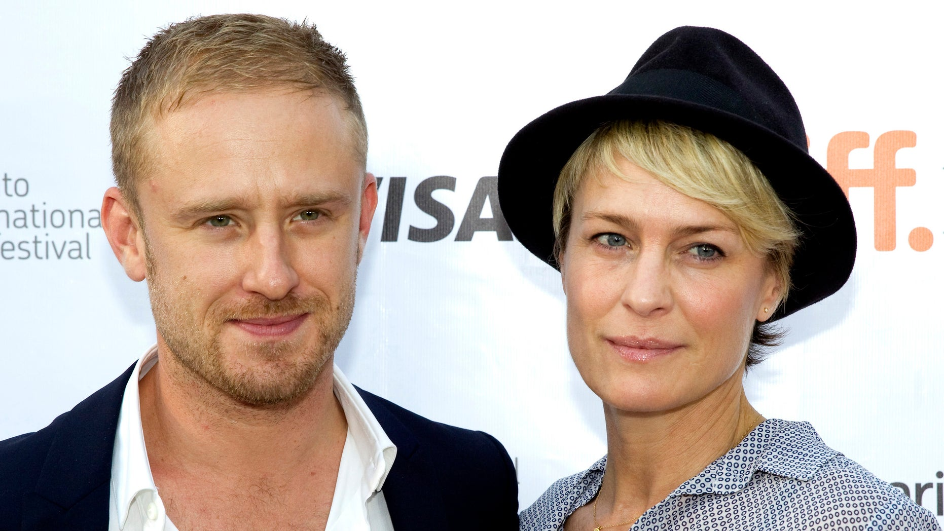 """September 10, 2013. Cast member Ben Foster and girlfriend Robin Wright arrive for the film premiere of """"Kill Your Darlings"""" at the 38th Toronto International Film Festival in Toronto."""