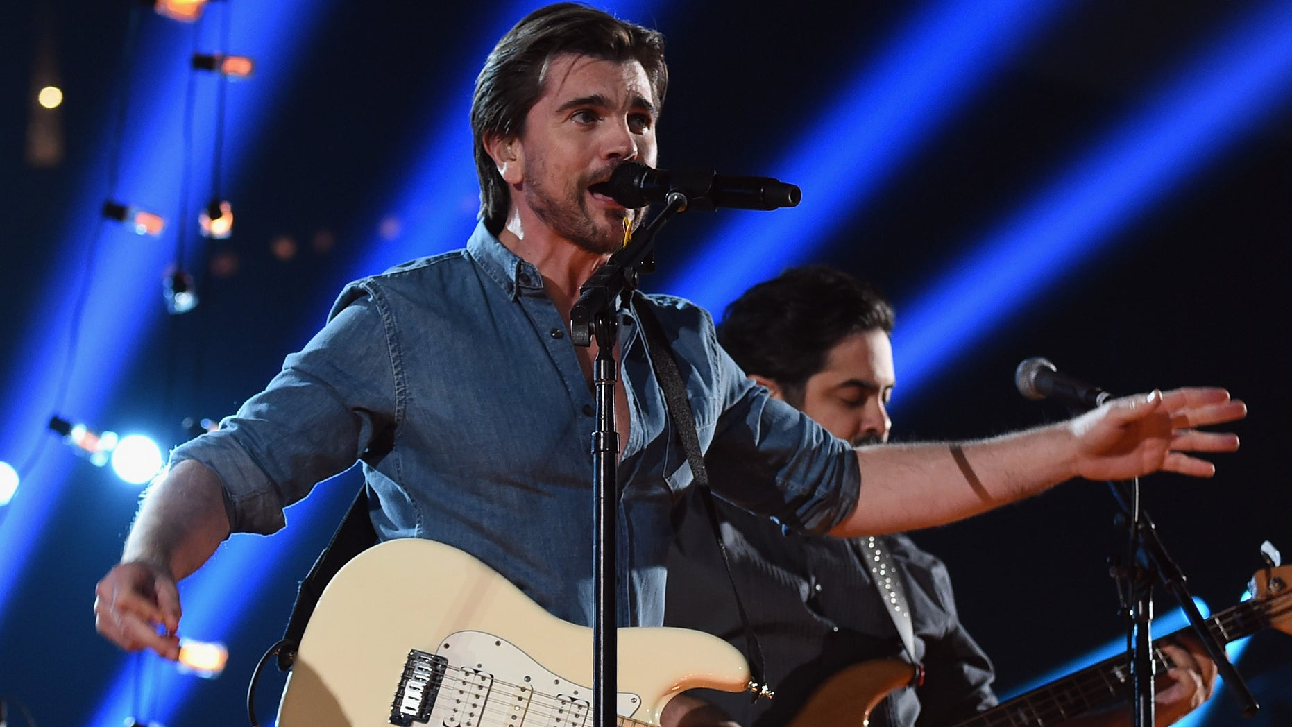 LOS ANGELES, CA - FEBRUARY 08:  Recording Artist Juanes performs onstage during The 57th Annual GRAMMY Awards at the STAPLES Center on February 8, 2015 in Los Angeles, California.  (Photo by Larry Busacca/Getty Images for NARAS)