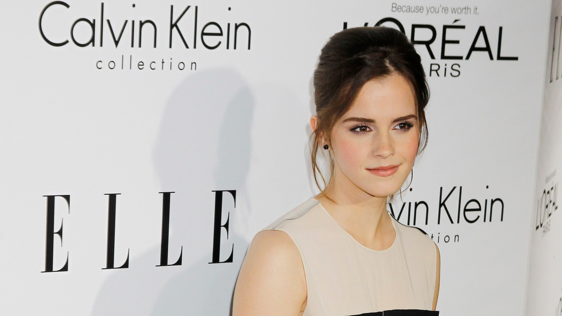 Honoree Emma Watson poses as she arrives at the 19th Annual ELLE Women in Hollywood dinner in Beverly Hills, California October 15, 2012. The event honors women who have had a profound impact on the film industry.